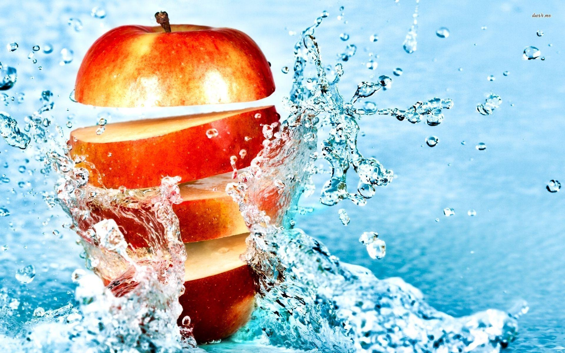 Sliced Apple In The Water Wallpaper