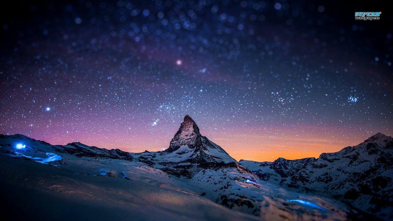 Starry night sky over the mountains wallpapers