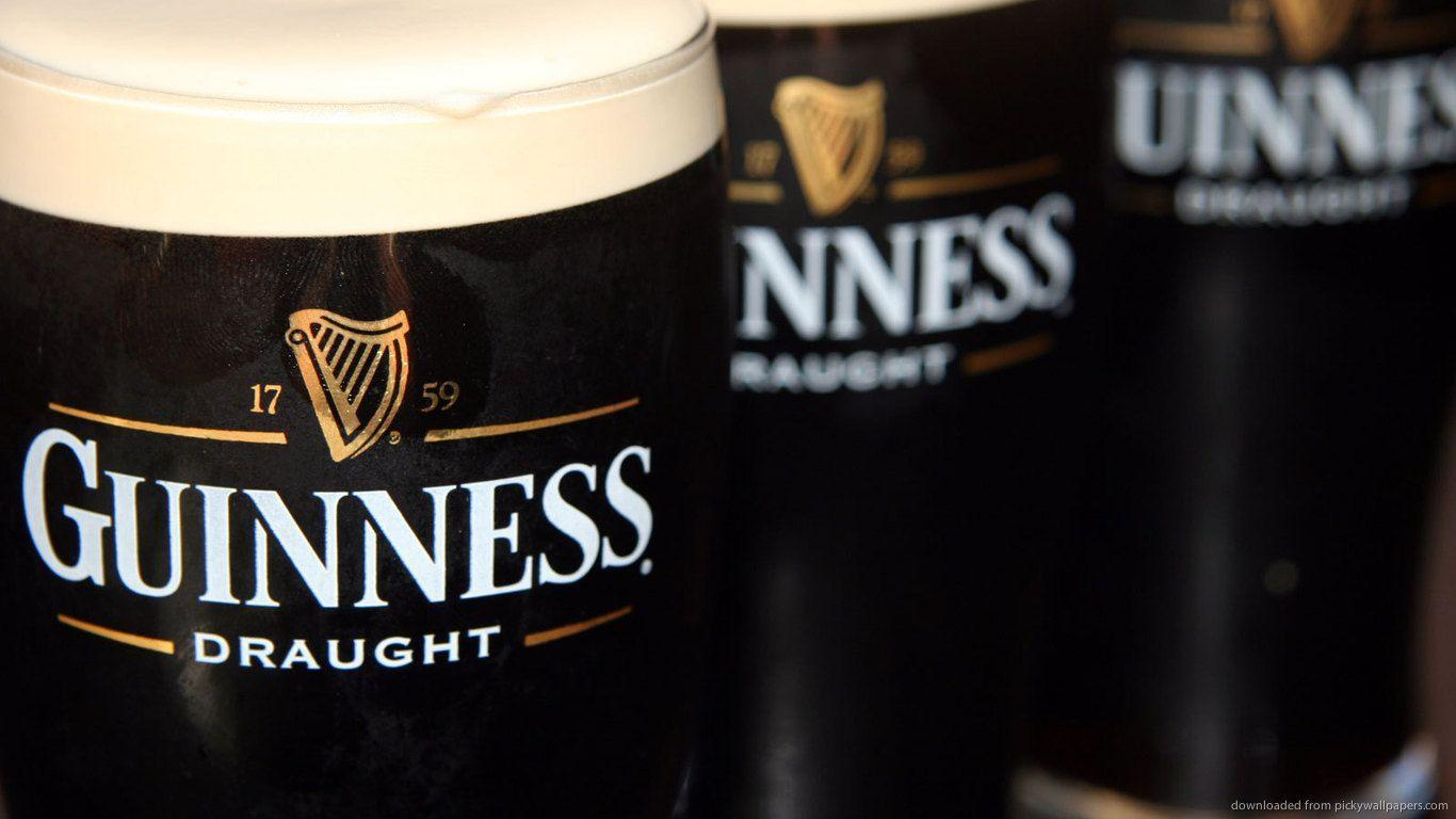Download 1366x768 Three Full Guinness Draught Glasses Wallpaper