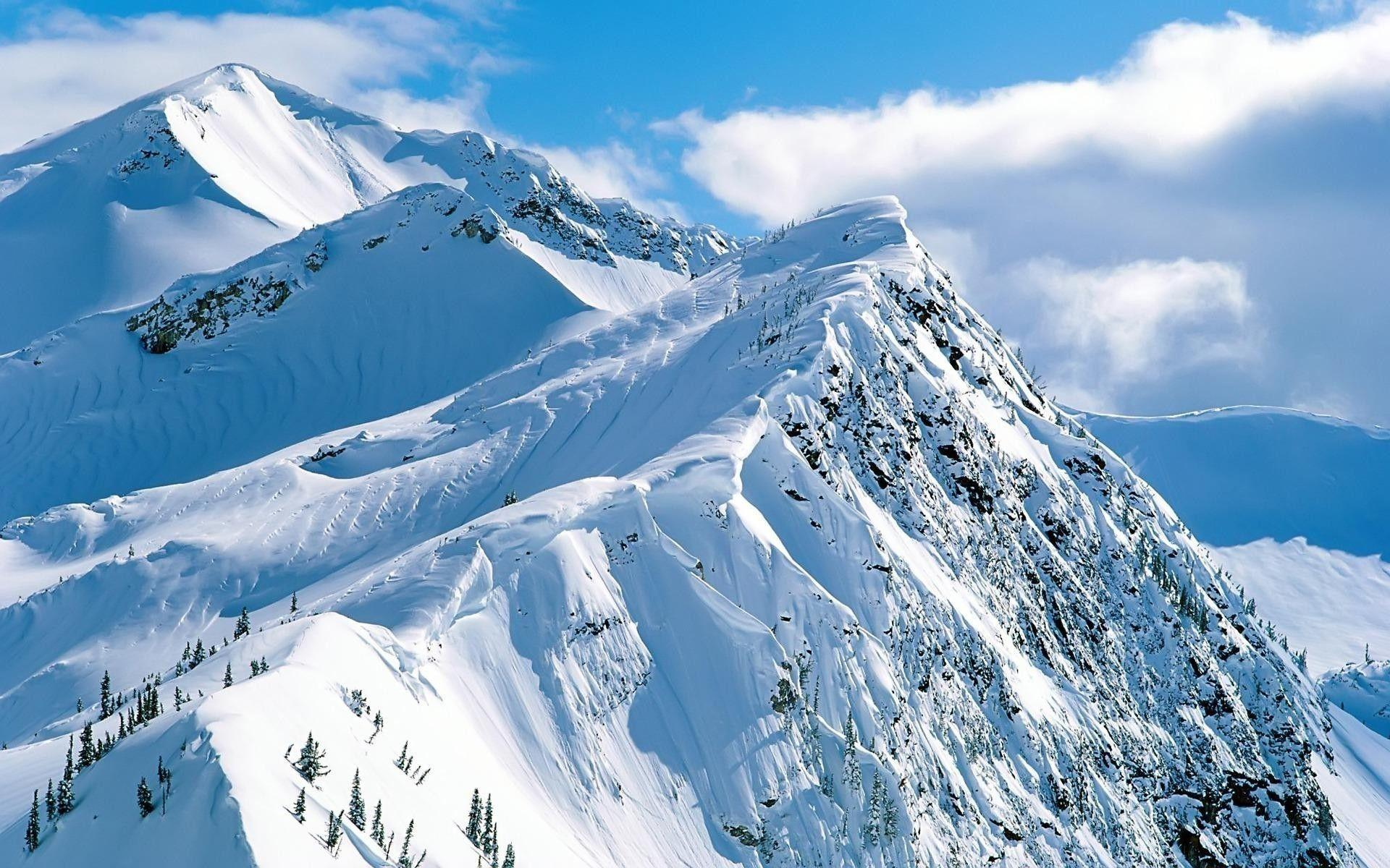 Snowy mountain peak Wallpapers #