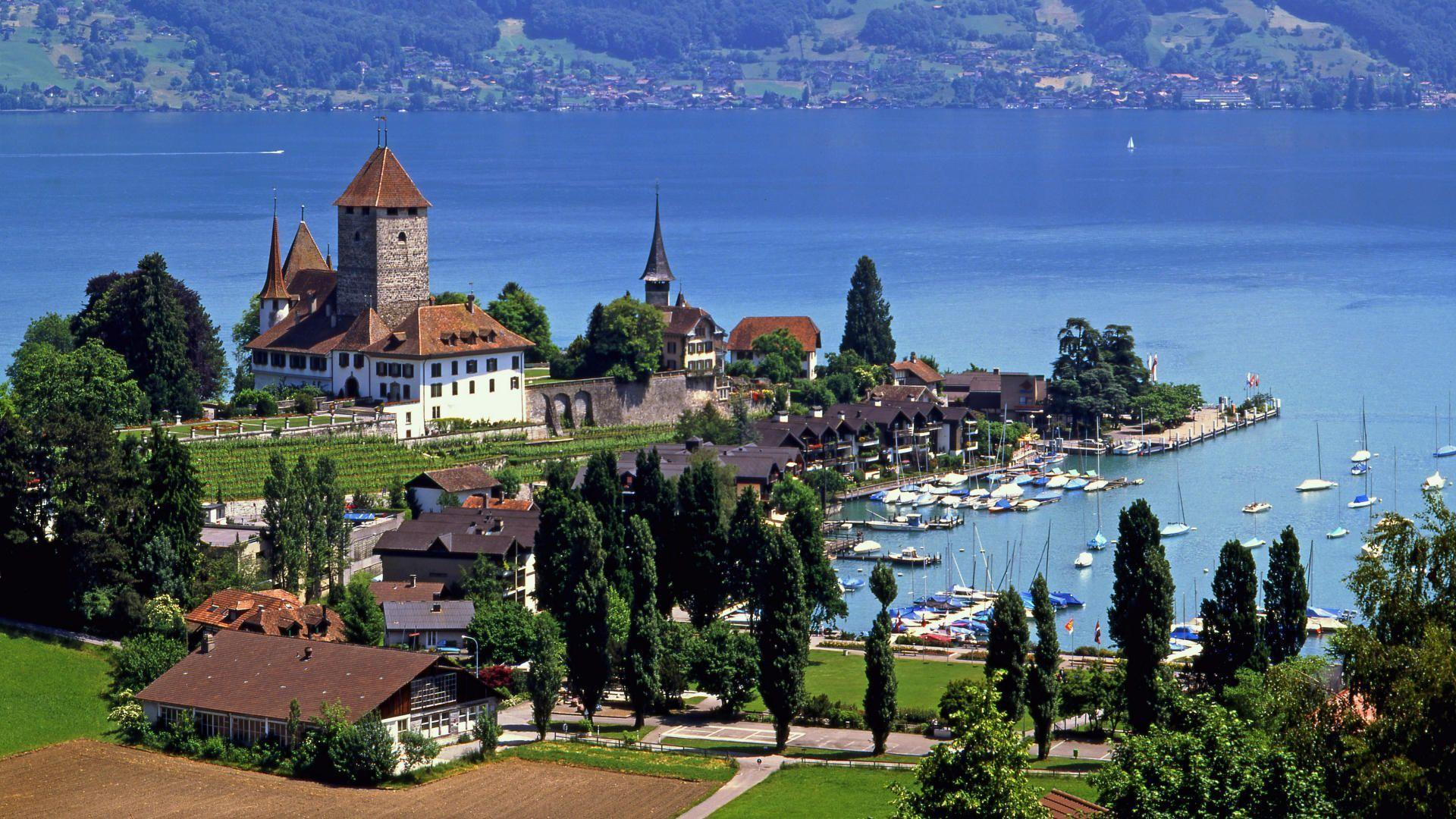 Spiez castle lake thun switzerland wallpaper Stock Free Images