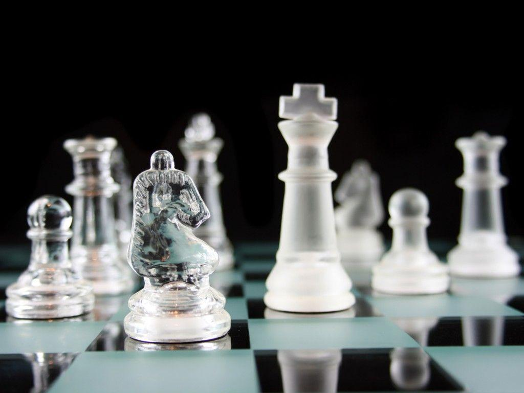 Glass Chess Pieces on a Frosted Glass Chess Board