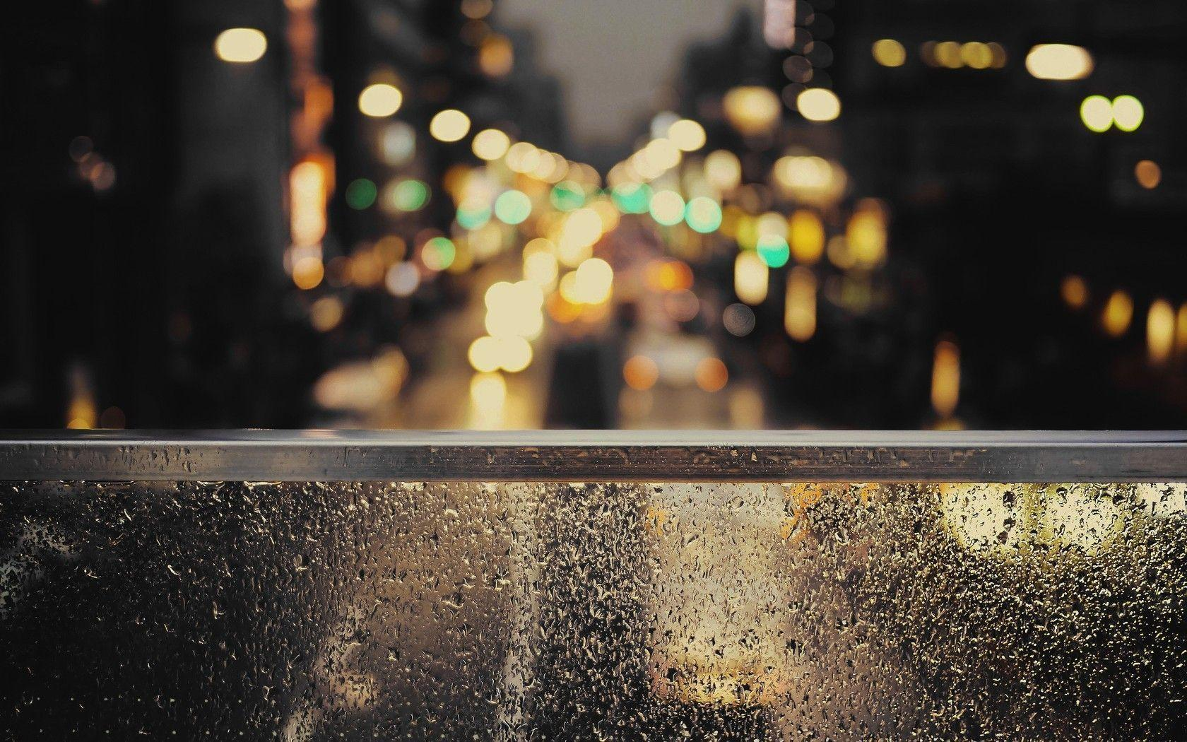 City Lights Beyond The Rainy Window Wallpaper