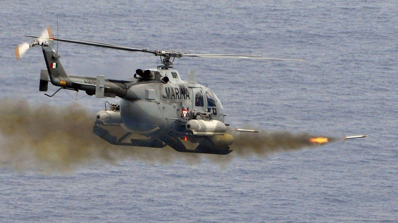Download 1366x768 Military Helicopter Firing Some Rockets Wallpapers