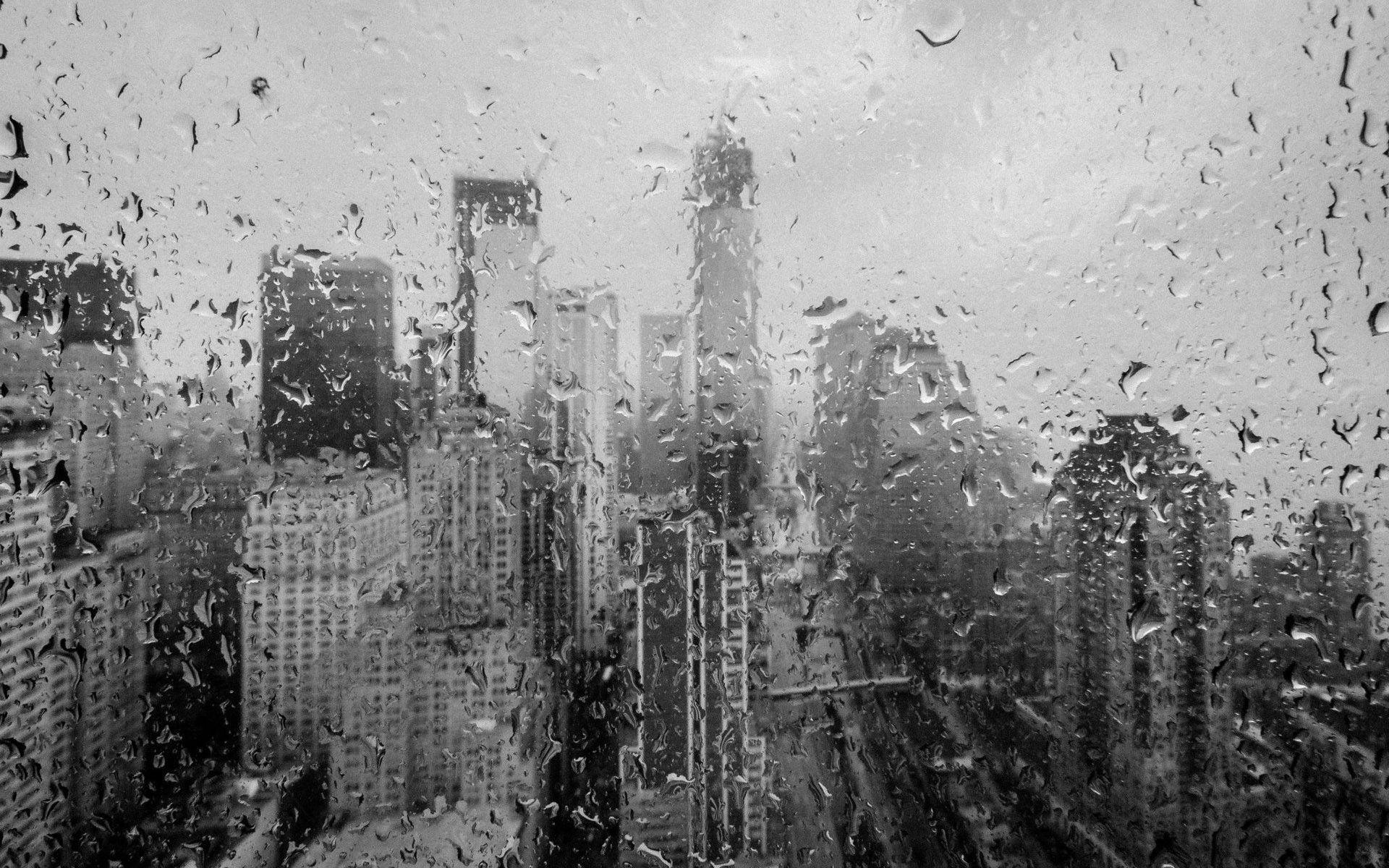 City View Through Wet Window Wallpaper