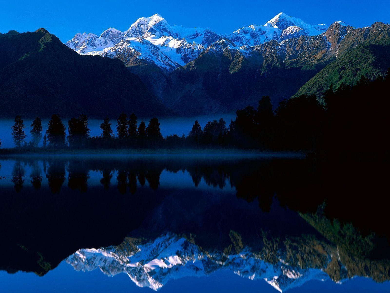 Lake Matheson Reflects Mount Tasman and Mount Cook New Zealand ...