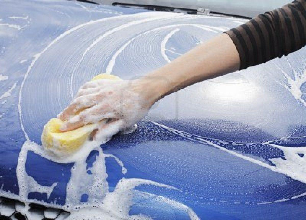 Hand Wringing Out Soapy Car Wash Sponge