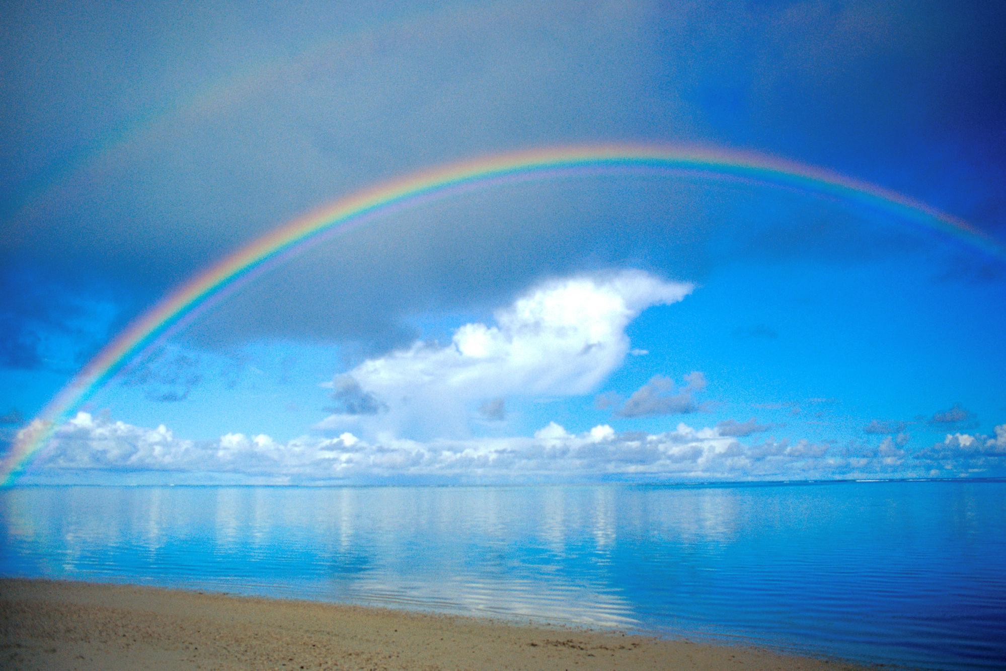 rainbow over sea free desktop background free wallpaper image