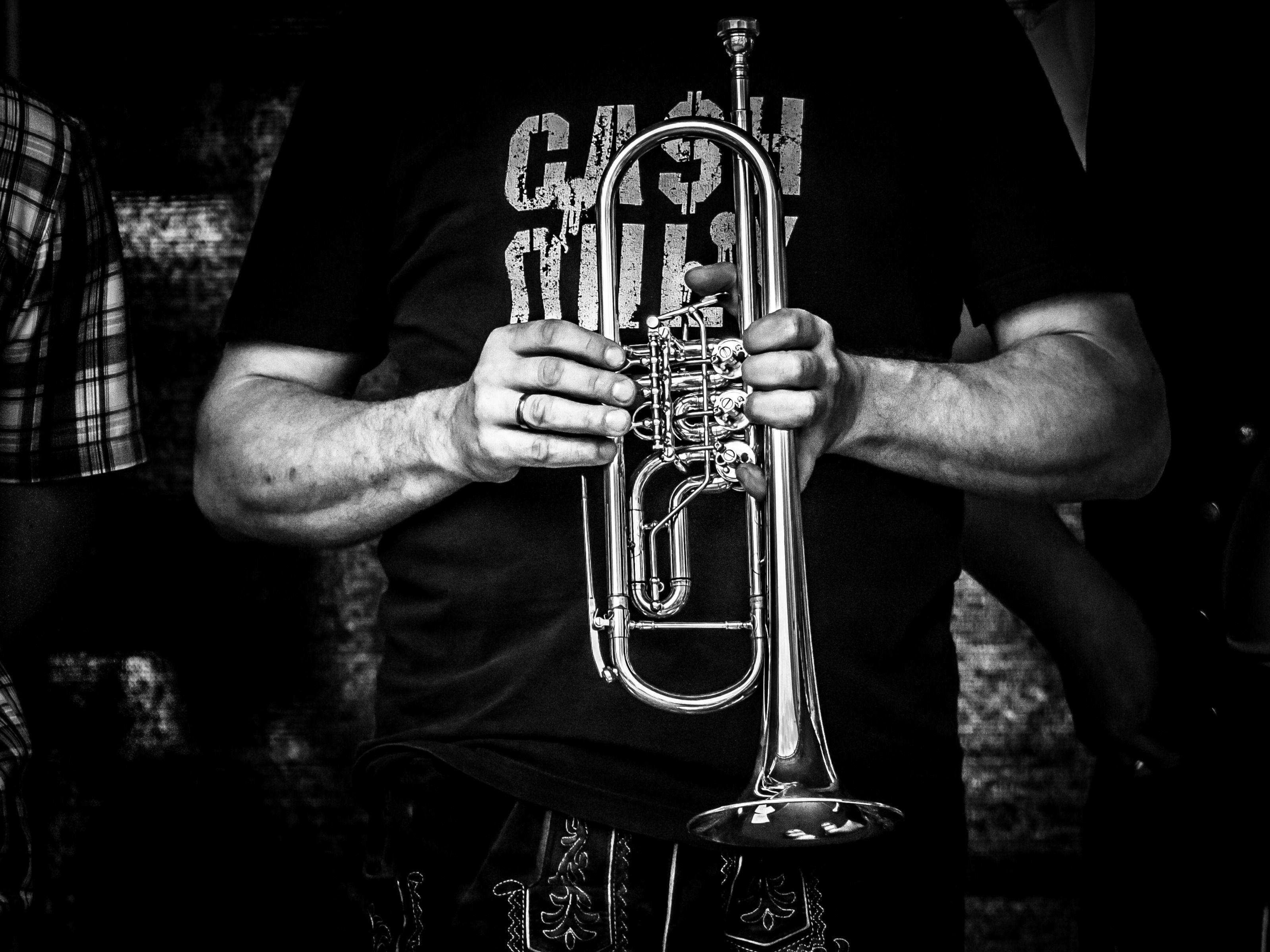 Man holding Trumpet in his Hands widescreen wallpapers