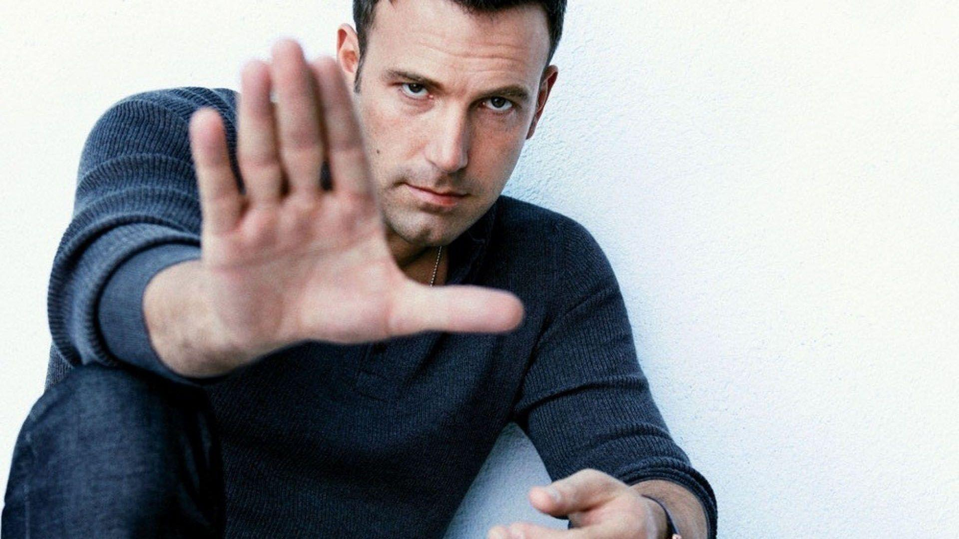 Ben Affleck making hand sign, looking at camera
