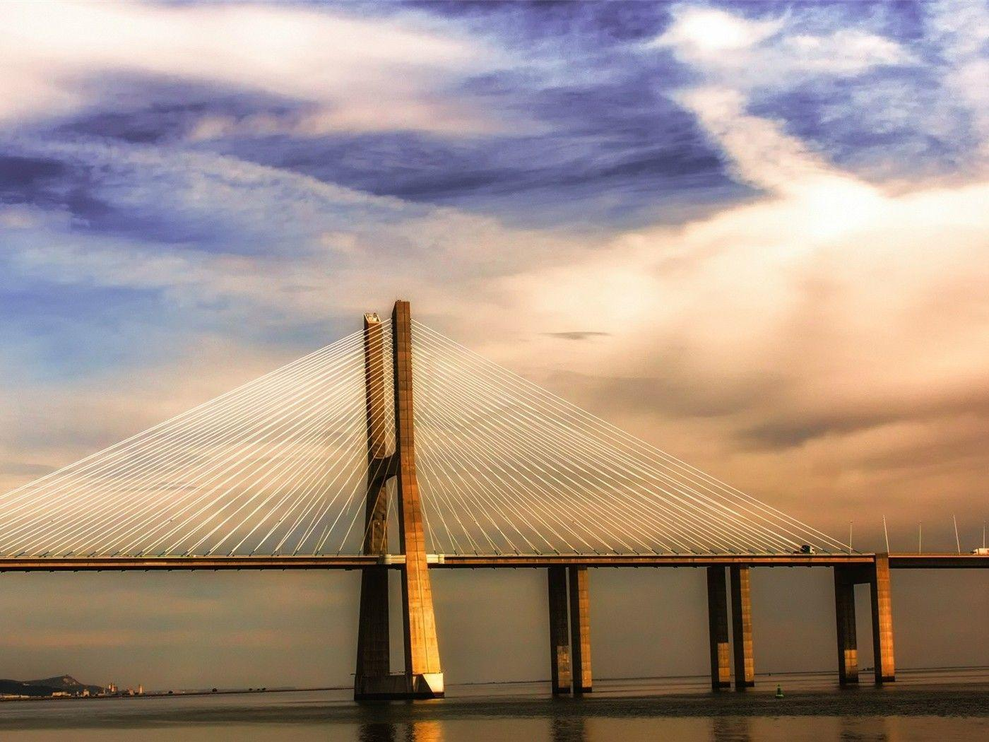 Modern bridge on the river tagus in lisbon wallpaper ...