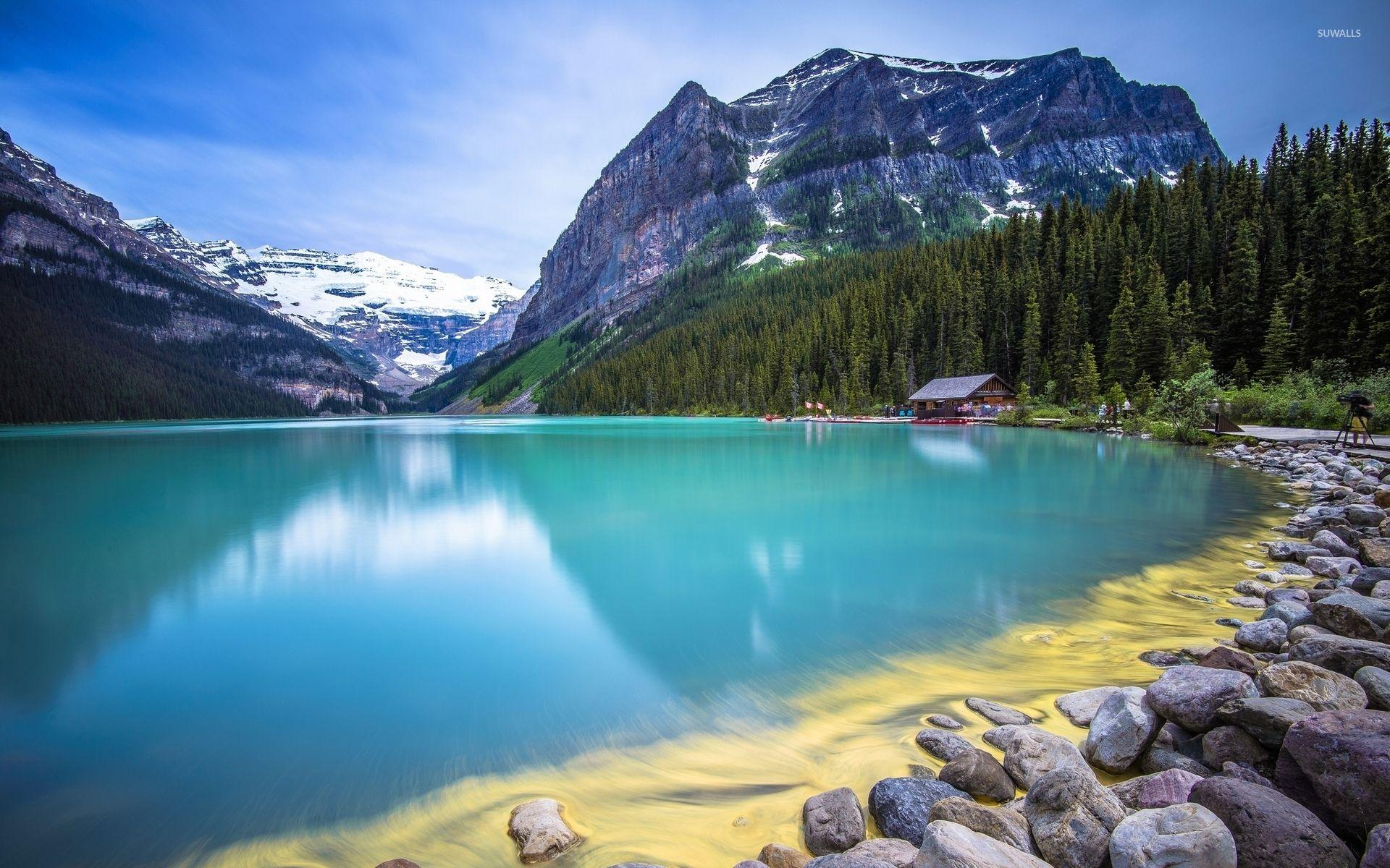 Amazing turquoise water lake guarded by rocky mountains wallpapers