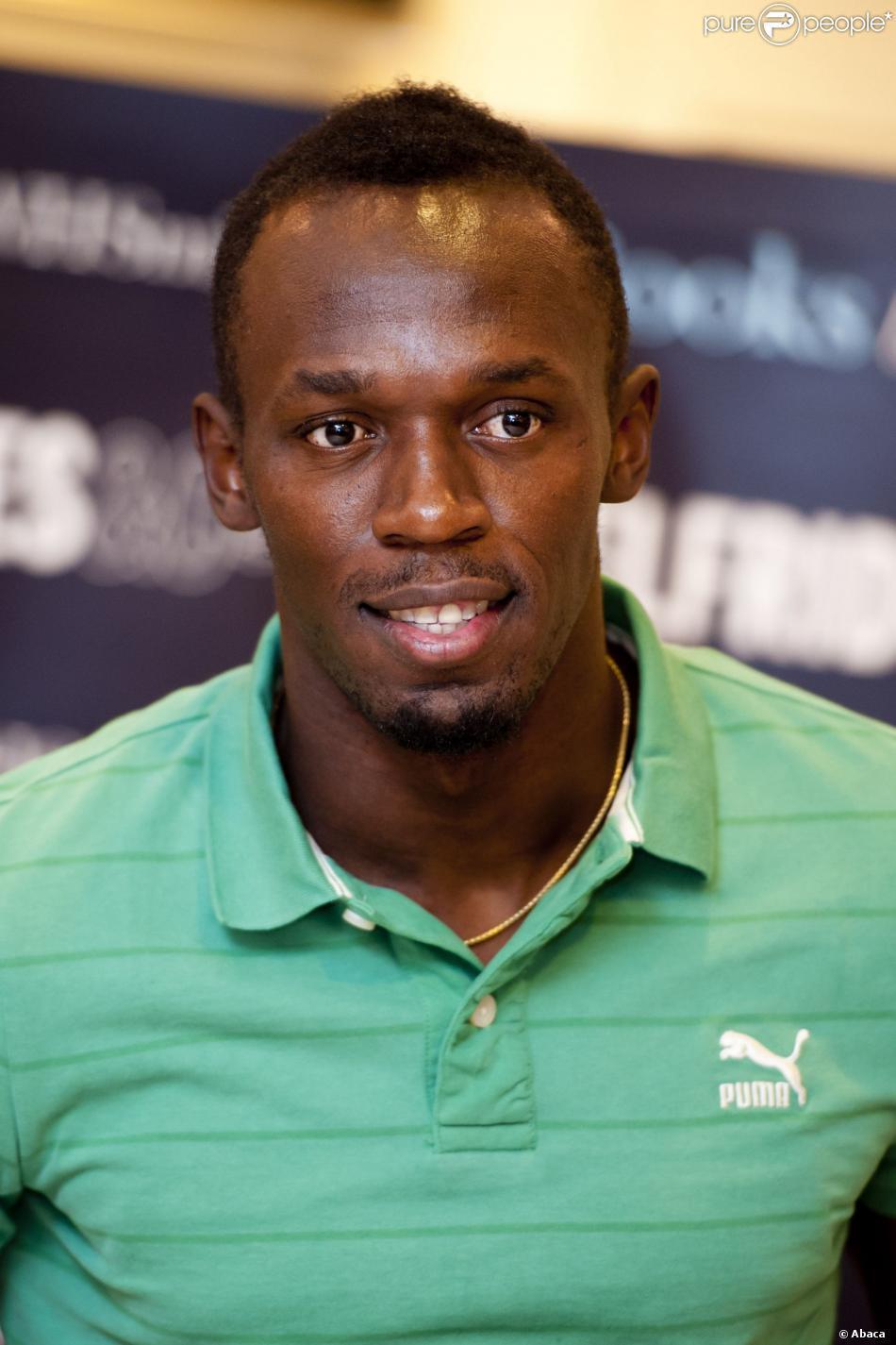Usain St Leo Bolt ur 21 sierpnia 1986 w Sherwood Content Trelawny jamajski lekkoatleta piłkarz sprinter ośmiokrotny mistrz olimpijski z Pekinu Londynu