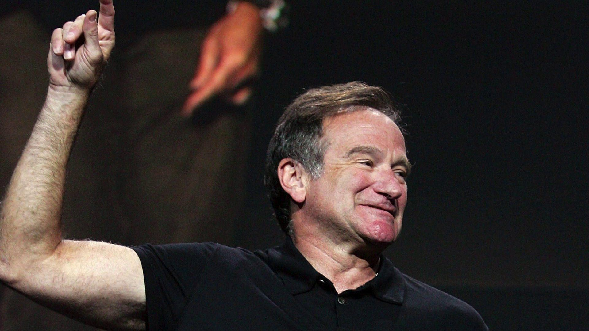 The famous Robin Williams shows his hand up wallpapers and images ...