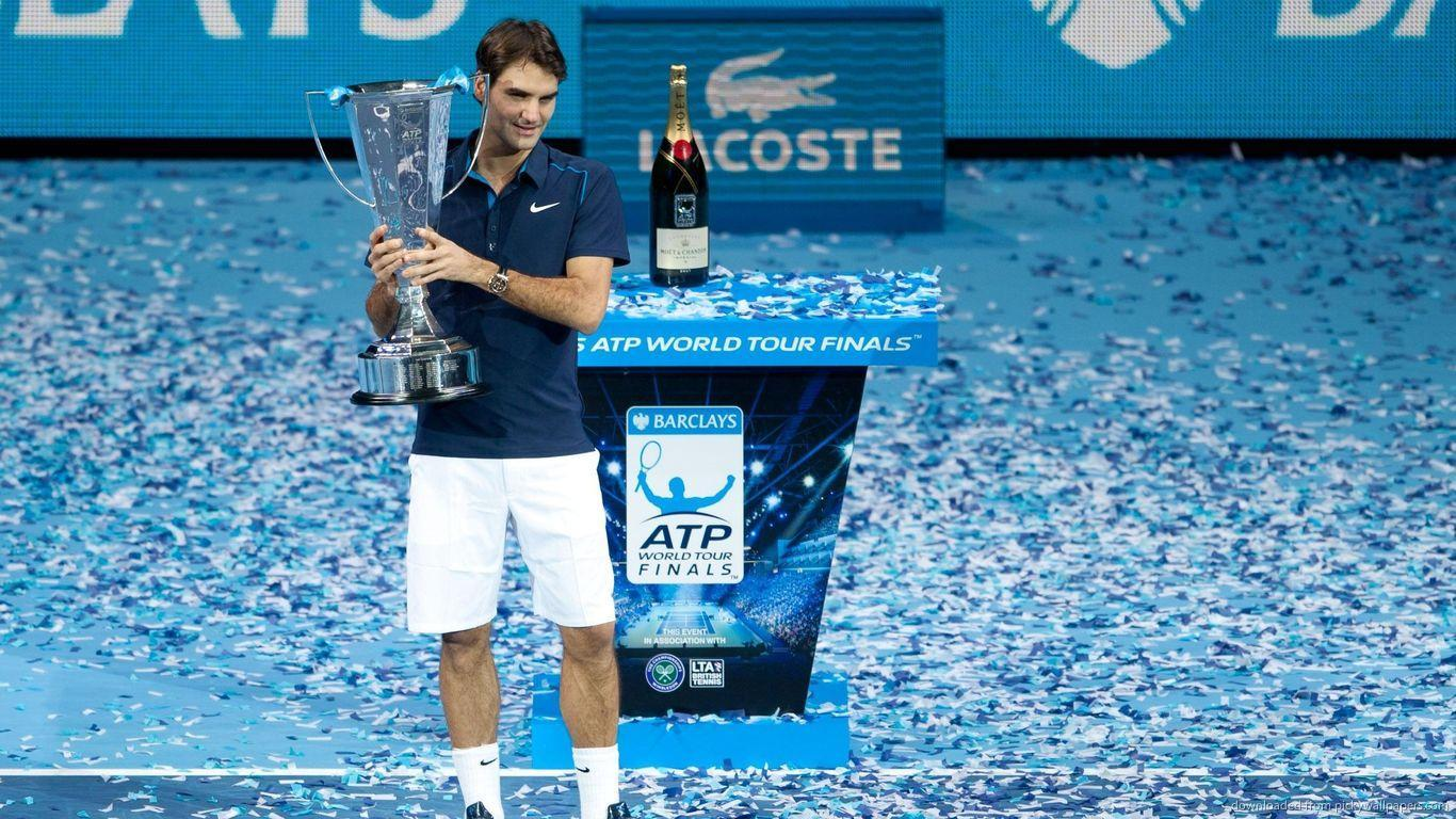Download 1366x768 Roger Federer With Cup Wallpapers