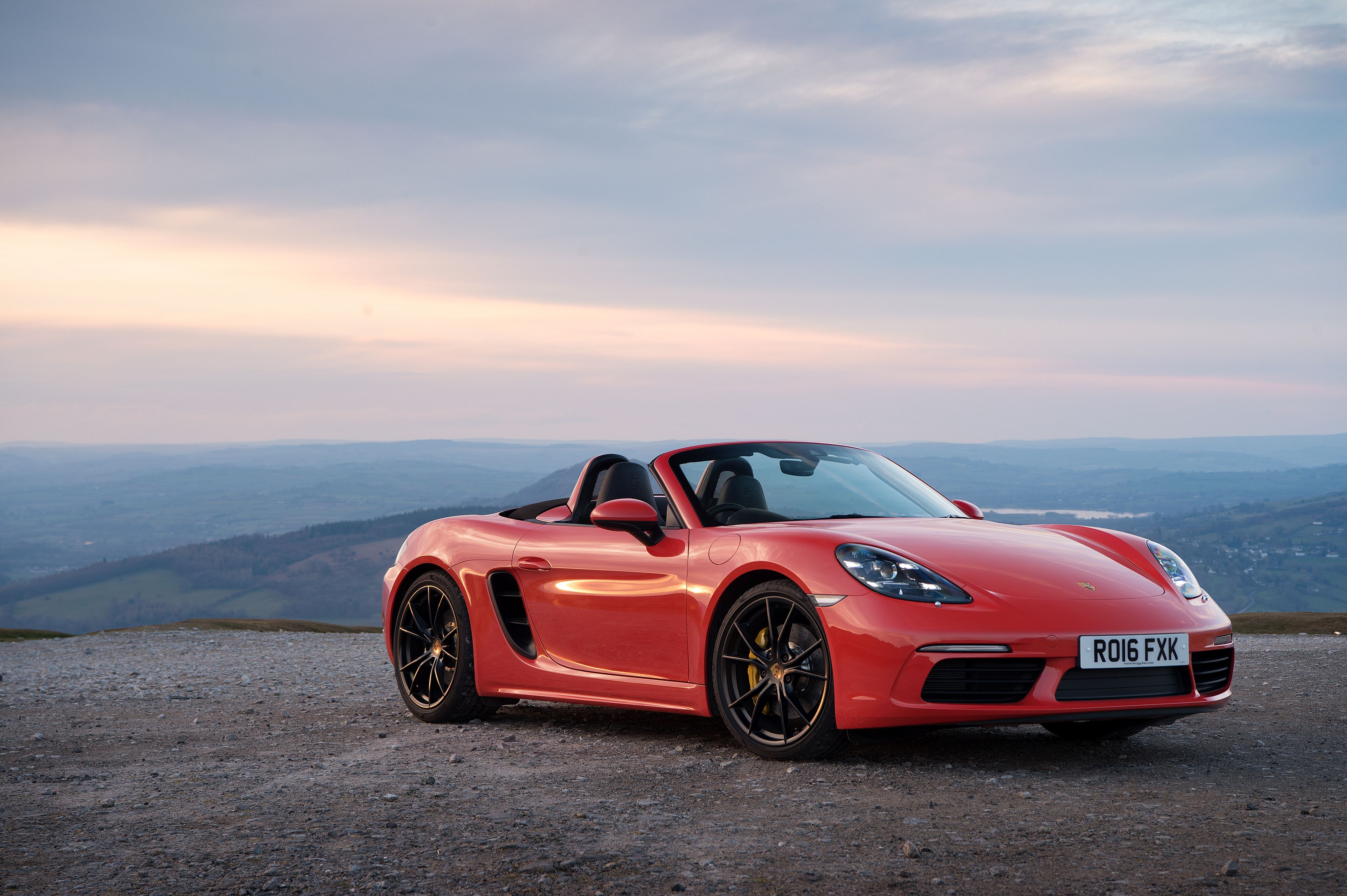 Red Car Convertible Porsche 718 Boxster on the backgrounds of the