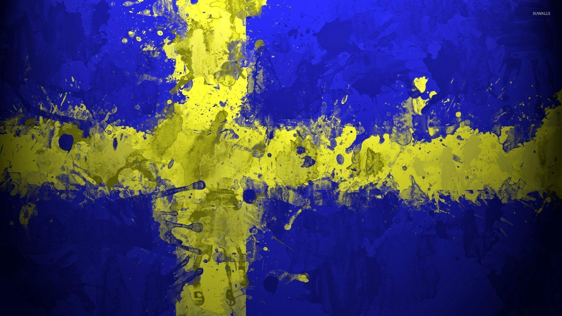 Paint drops on the flag of Sweden wallpapers
