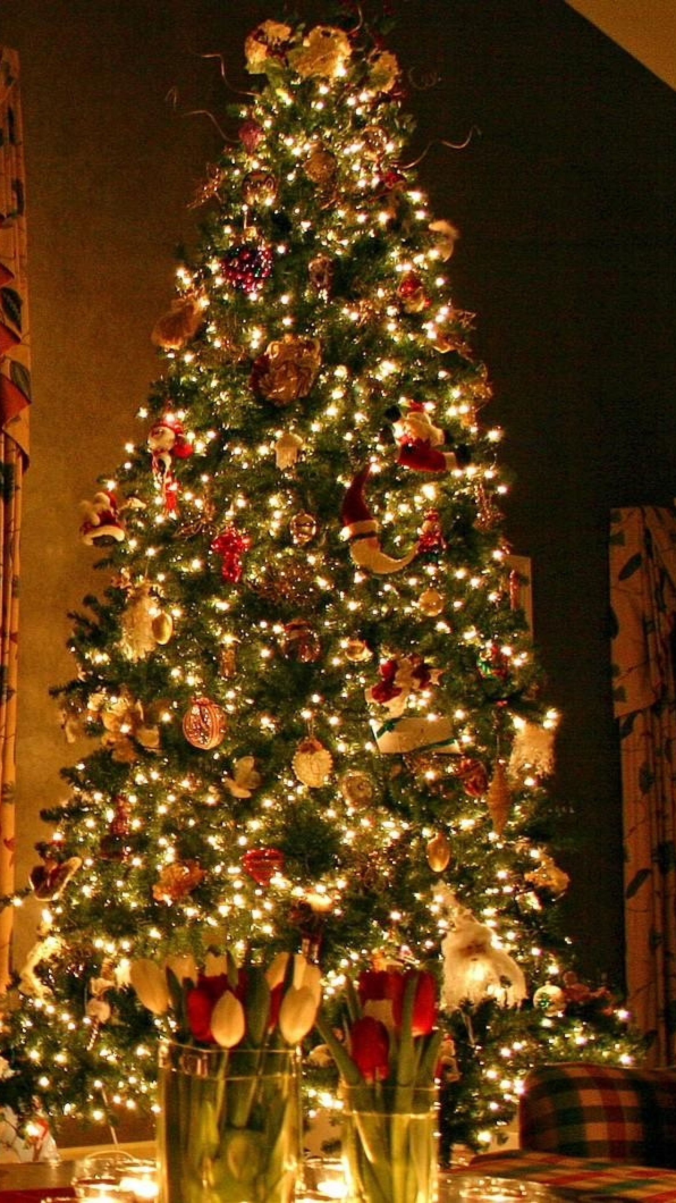 Download Wallpapers 2160x3840 Christmas tree, Ornaments, Fireplace