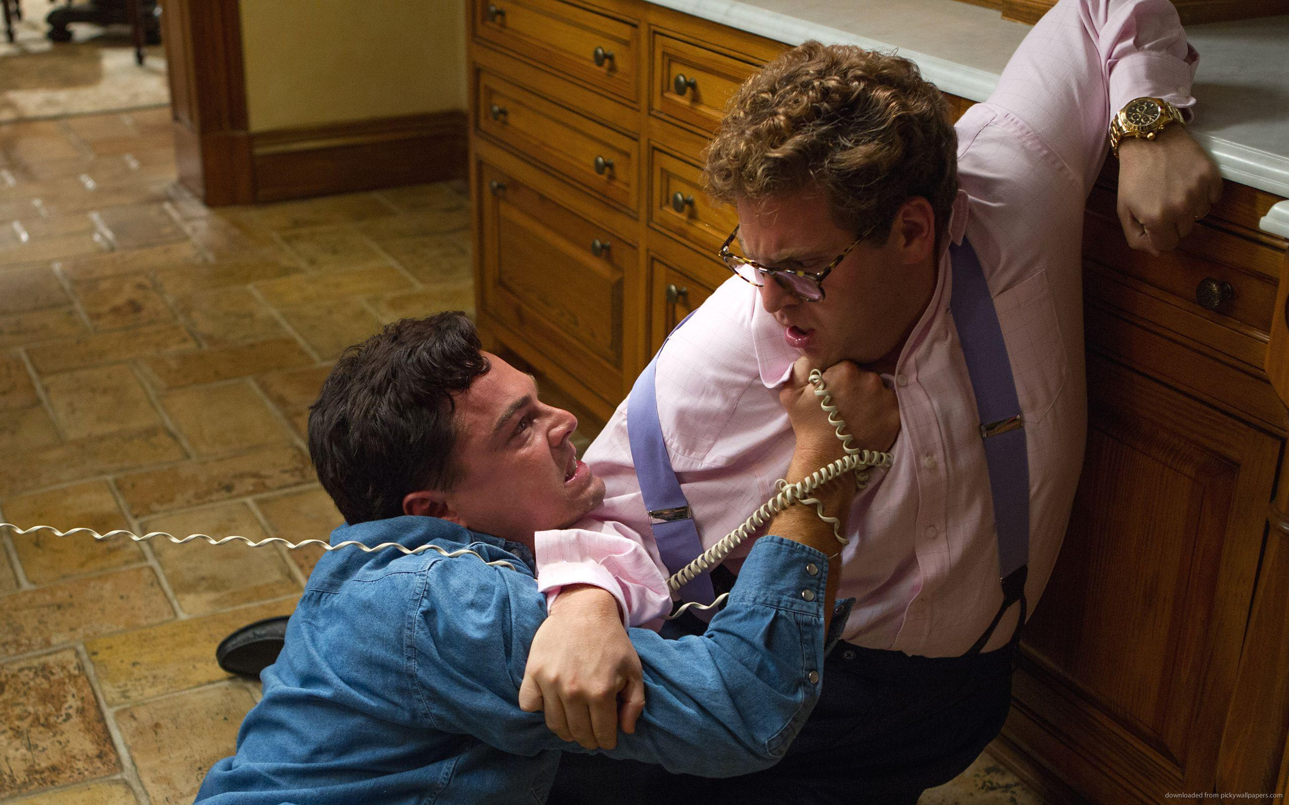 Download 2560x1600 Leonardo DiCaprio And Jonah Hill Fighting Wallpaper