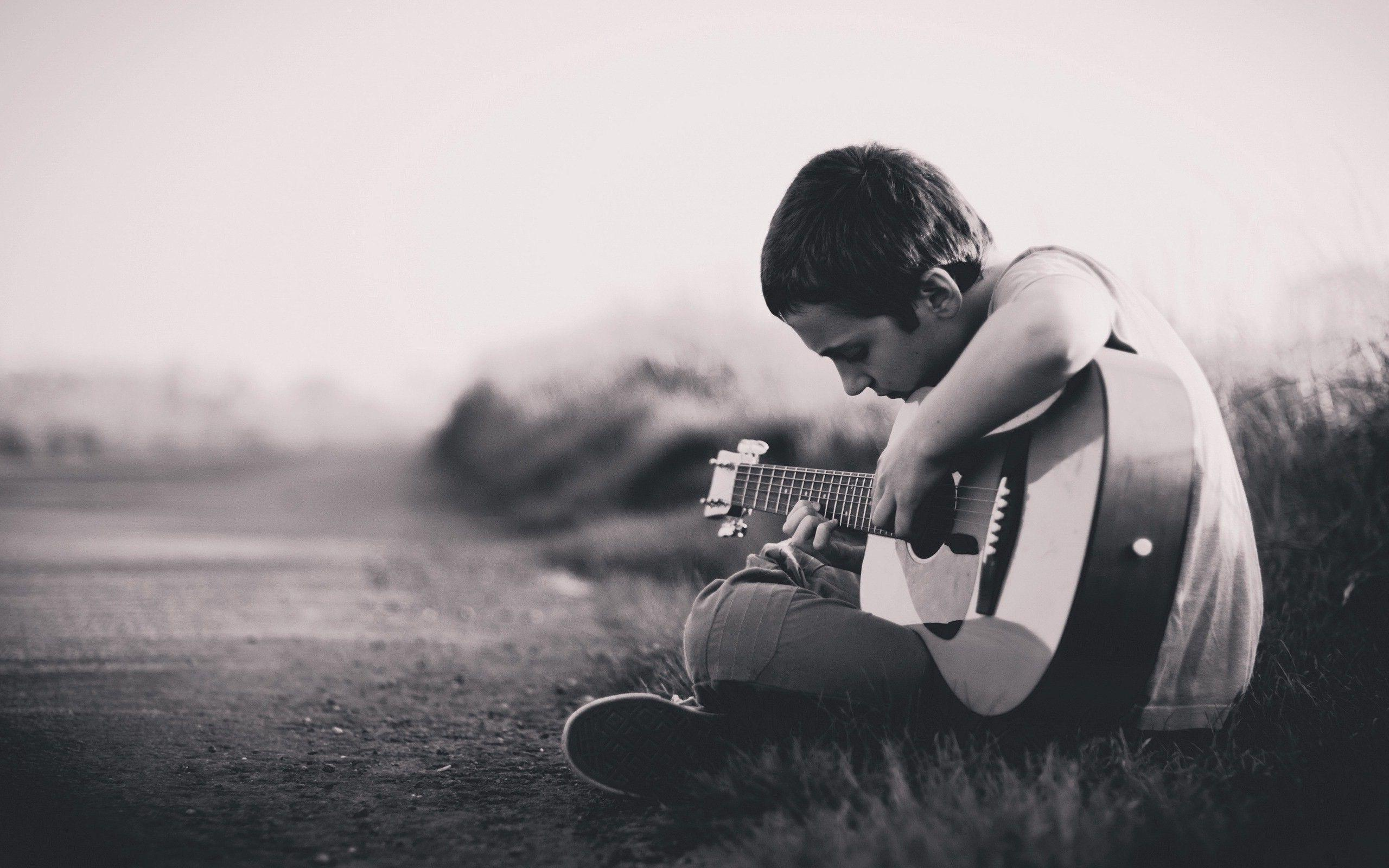 Lonely boy playing guitar hd wallpapers new hd wallpapers