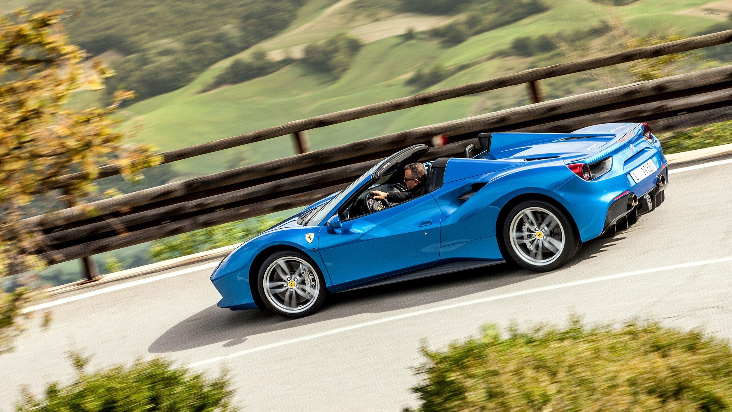 Blue Ferrari 488 Spider on the road wallpapers