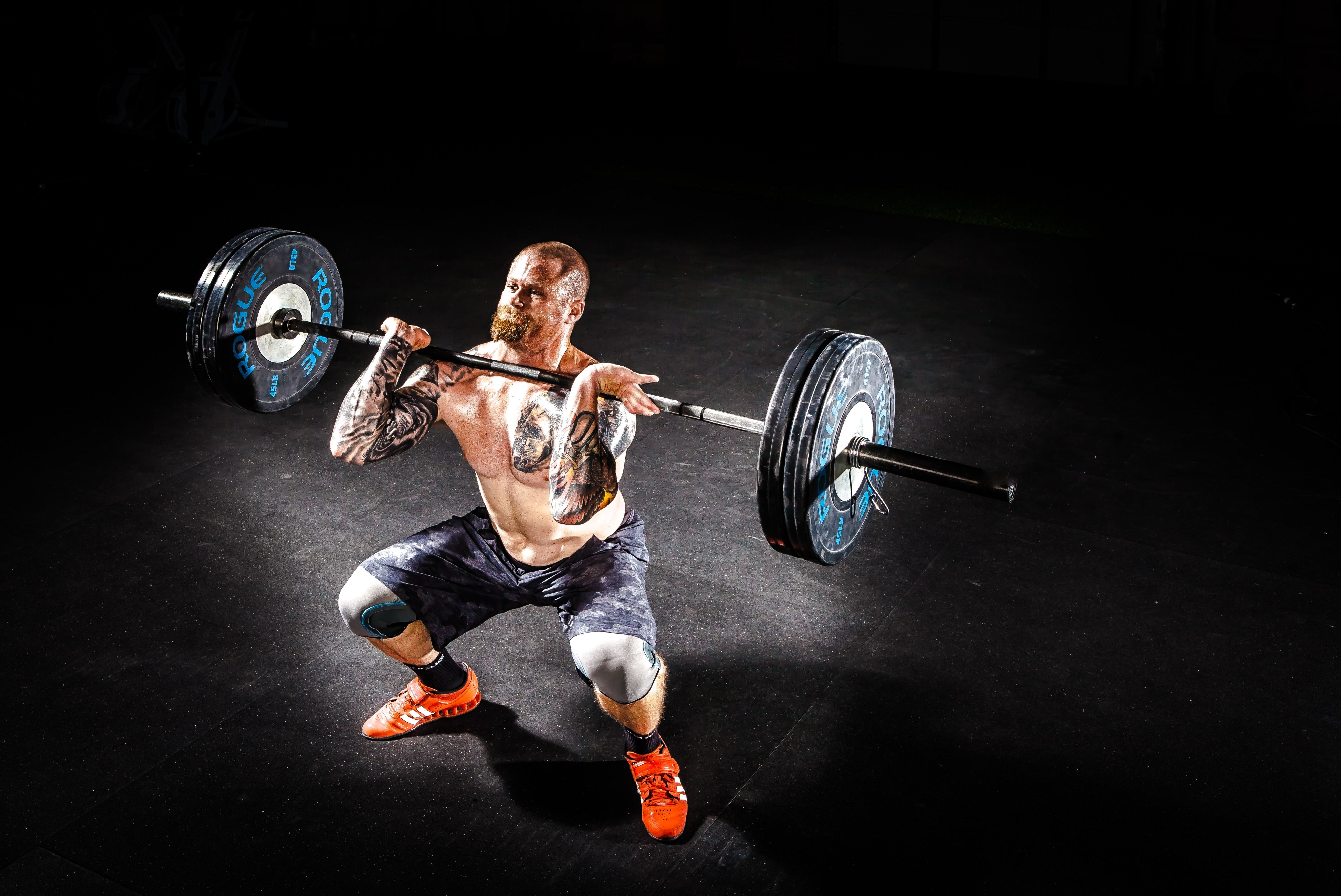 Man Lifting a Barbell · Free Stock Photo