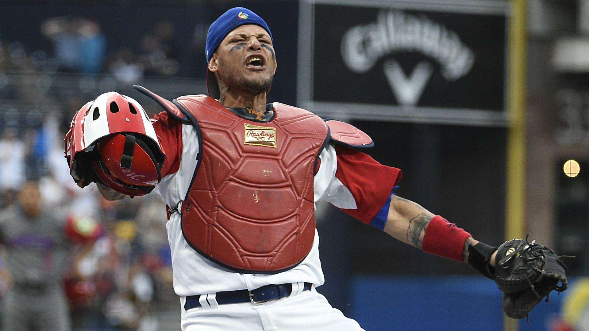 The internet wants to know how a ball got stuck to Yadier Molina's