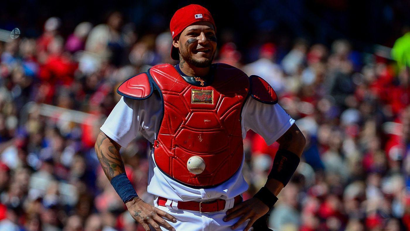 catcher Yadier Molina can't find the ball because it's stuck to