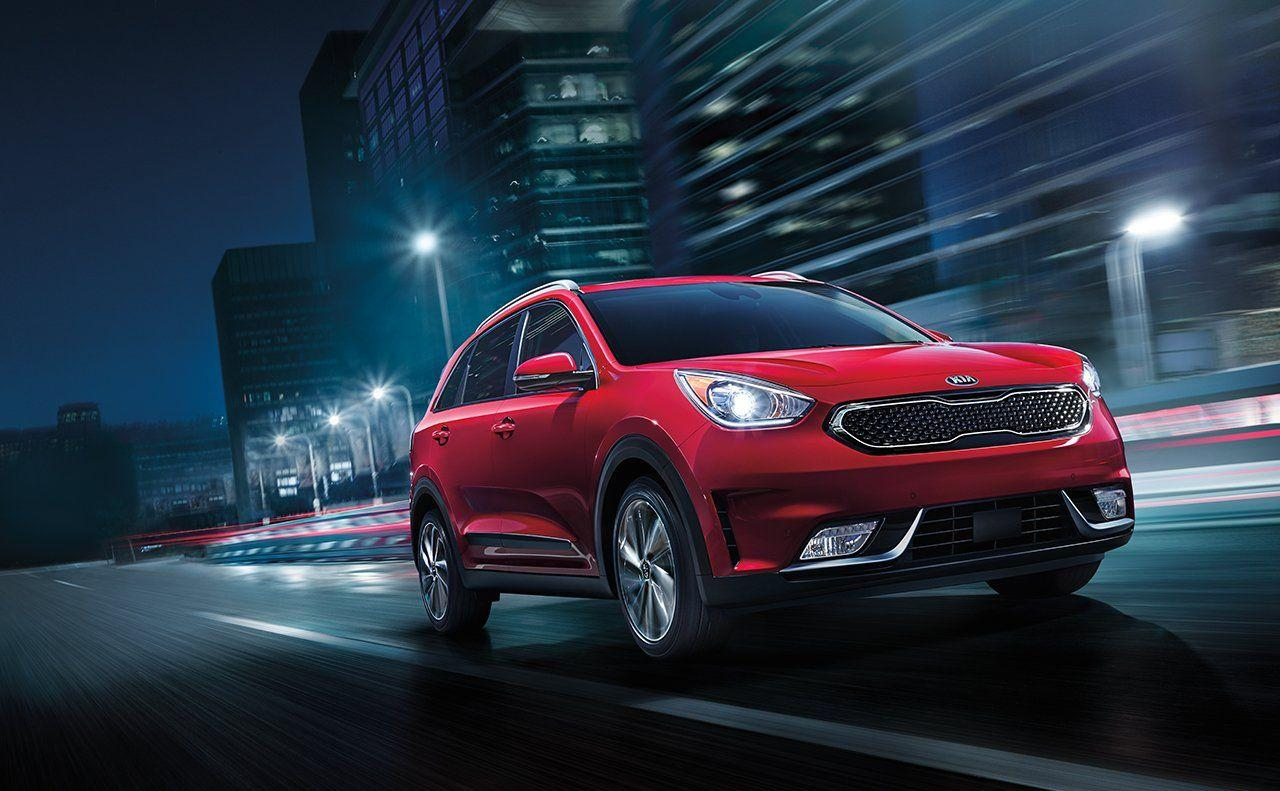 2019 Kia Niro EV red color night on road in city lights backgrounds