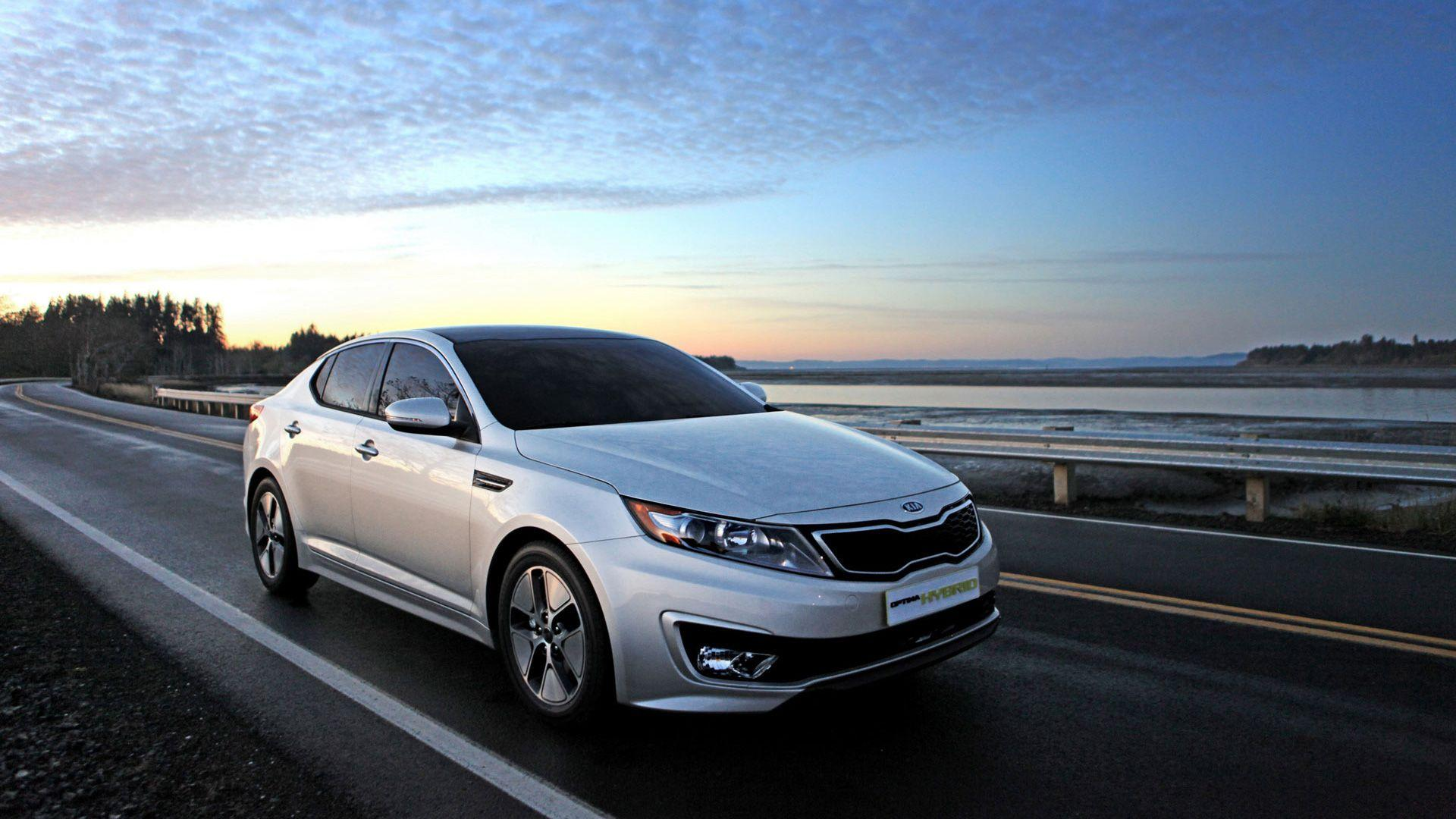 Kia Optima Hybrid Running on Highway Wallpaper