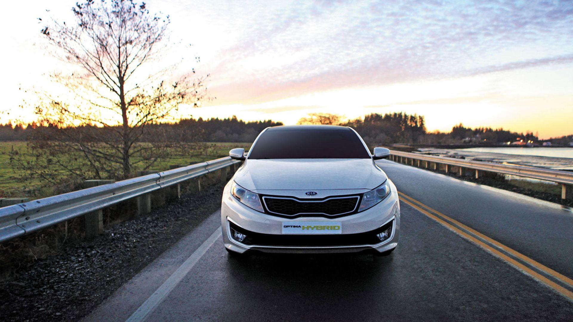 Front Pose of Kia Optima Hybrid On Highway Wallpaper