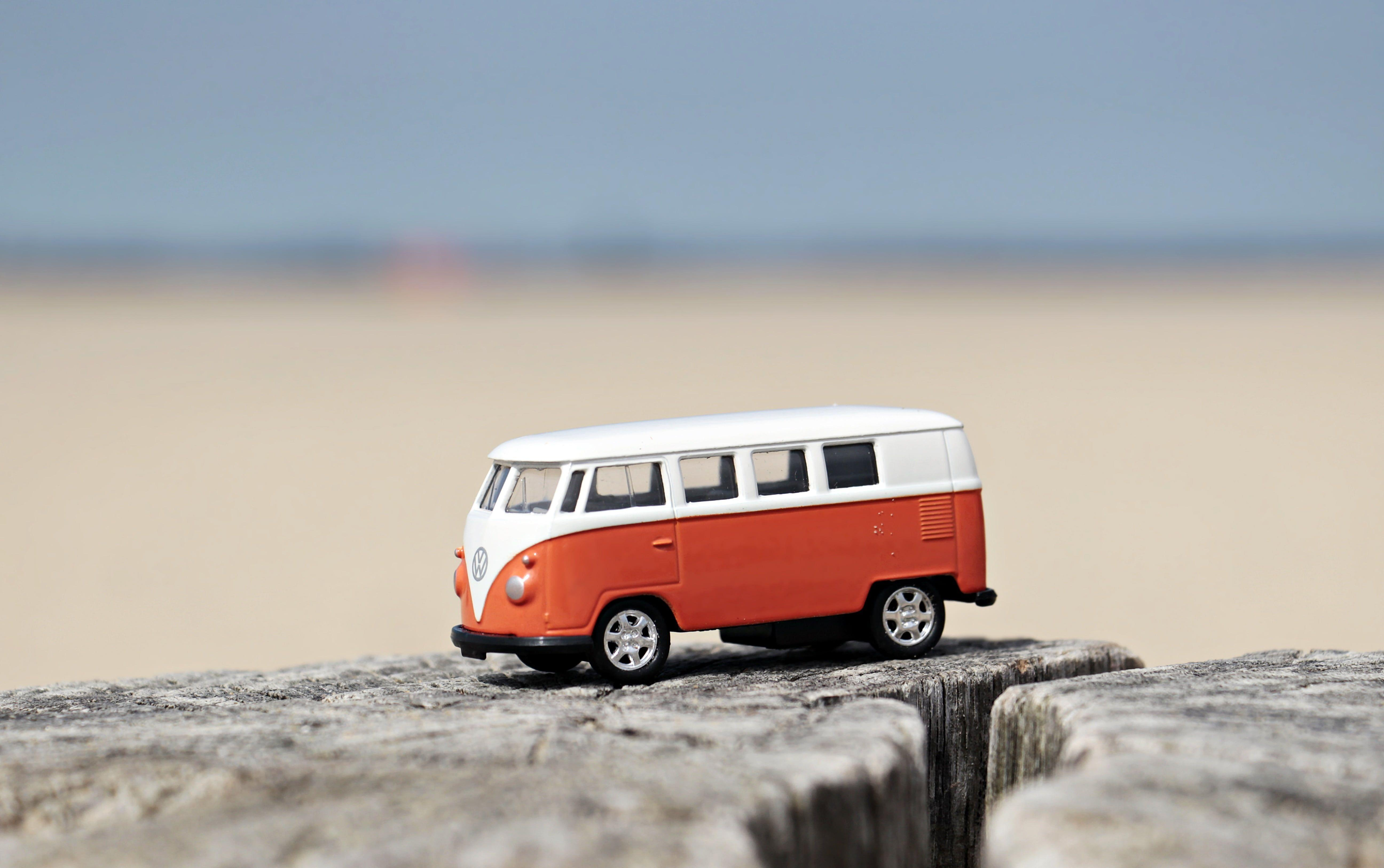 Selective focus photography of orange and white bus HD wallpapers