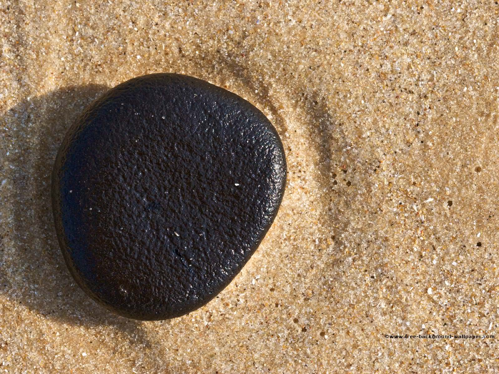 Black Pebble on a Beach Beach Background Wallpaper - 1600x1200 pixels