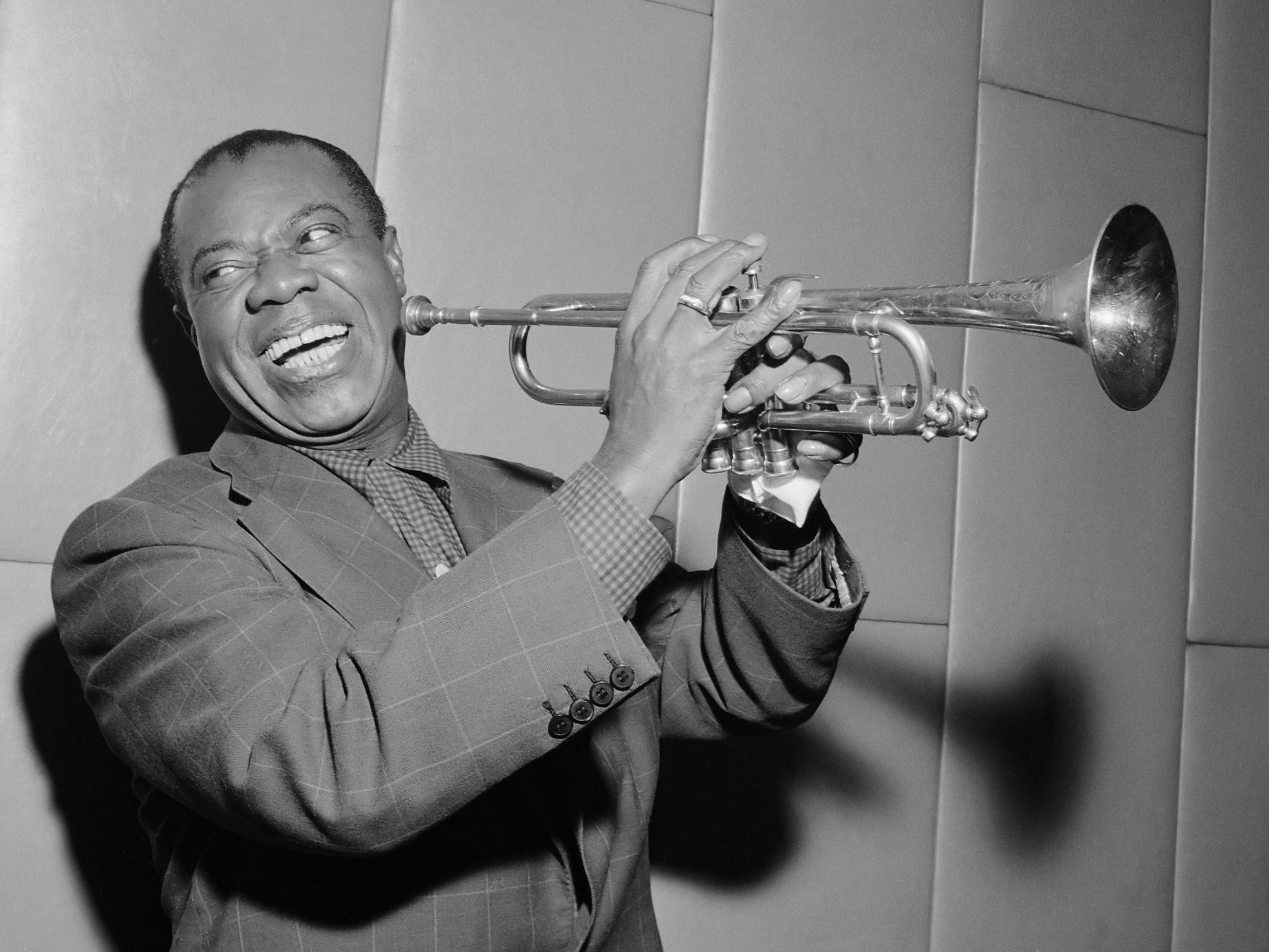 Louis laughing and playing his trumpet in 1955 | Satchmo | Pinterest ...