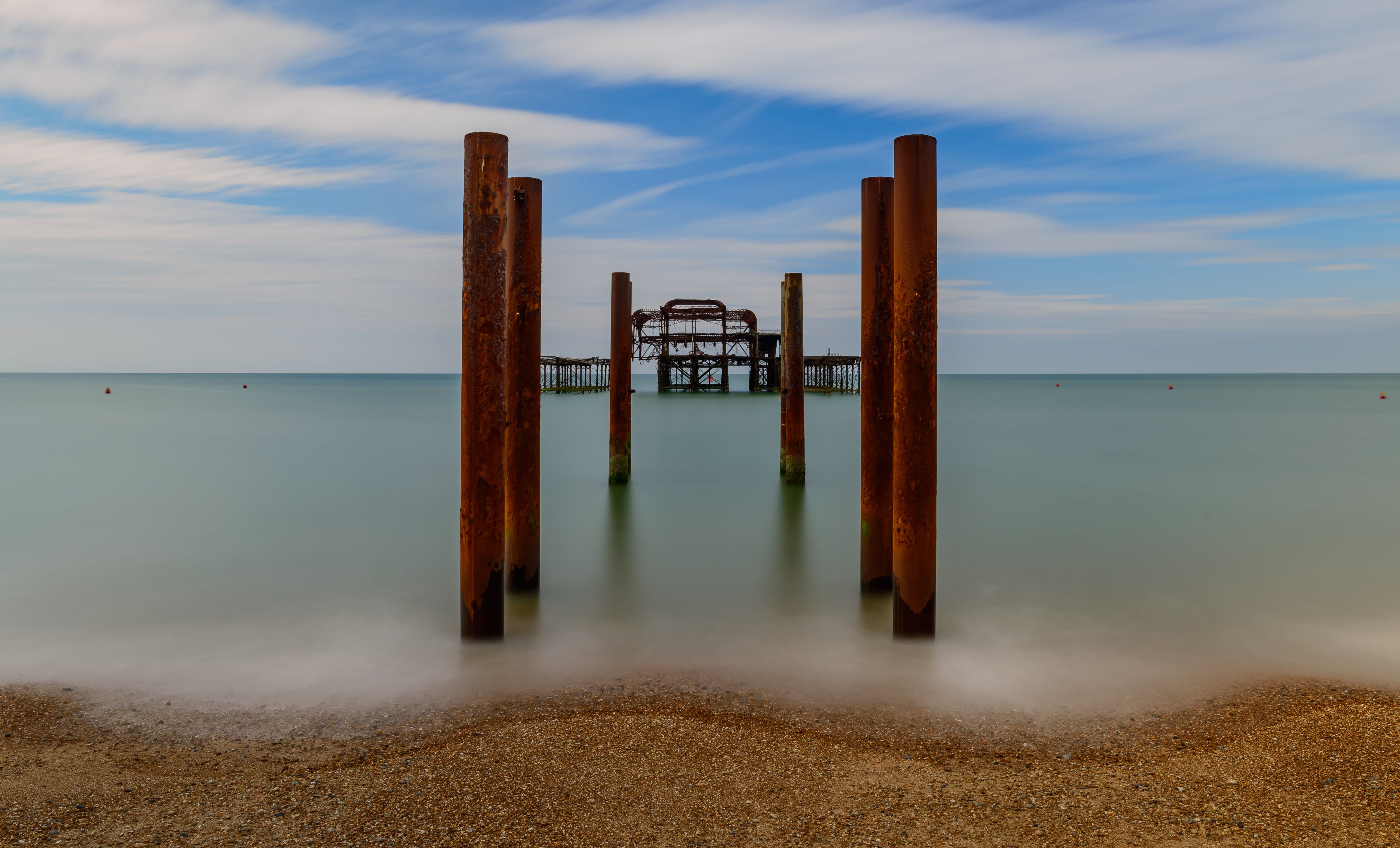 Brown wooden pillar on body of water, brighton HD wallpapers