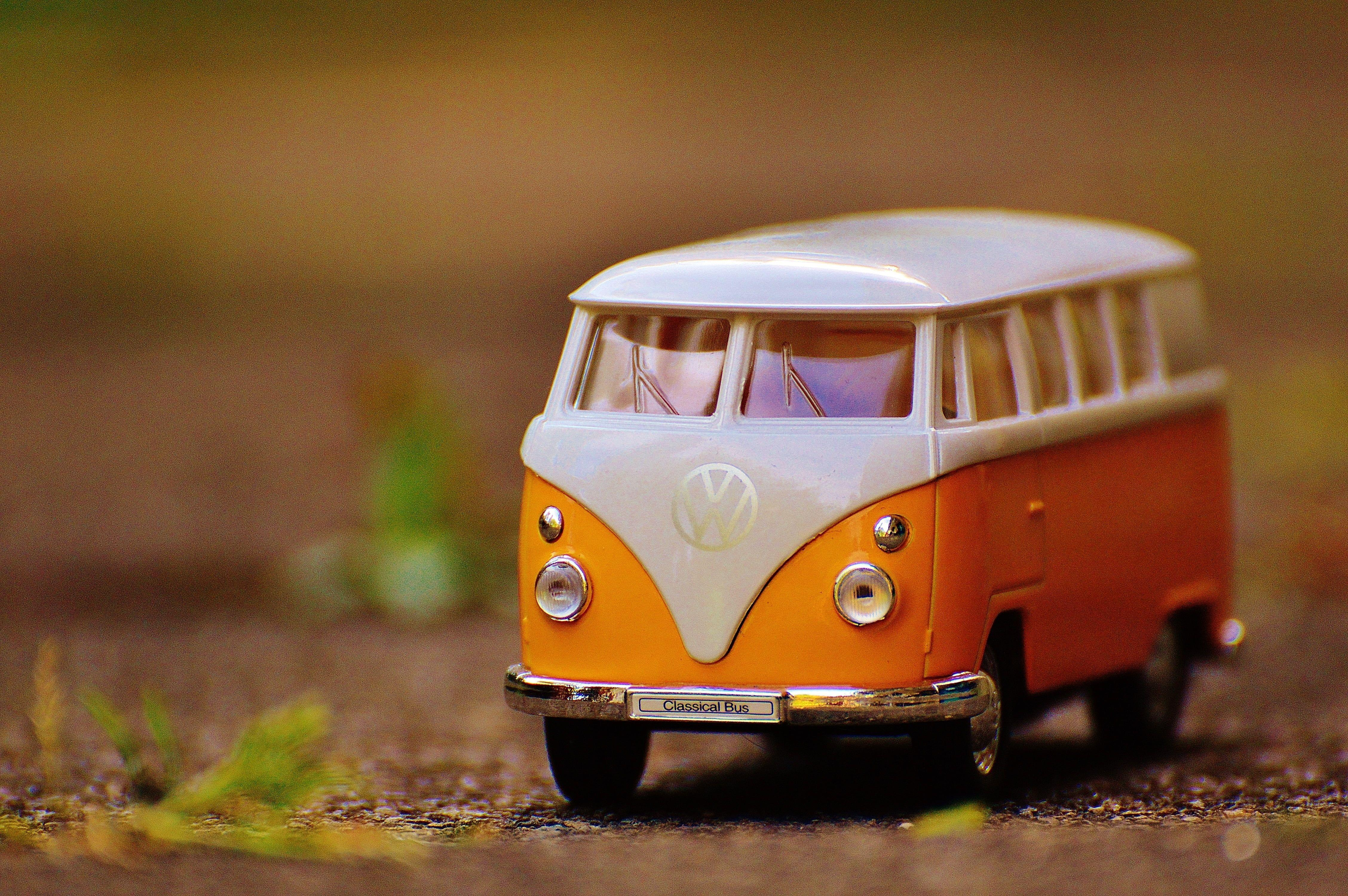 Orange and white Volkswagen bus toy HD wallpapers