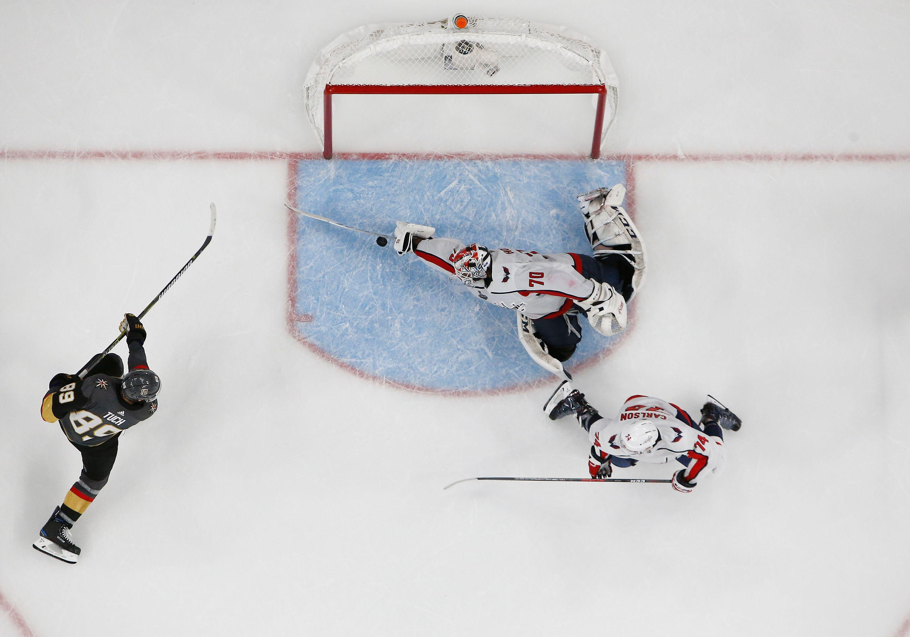An NHL photographer captured an incredible image of Holtby's save