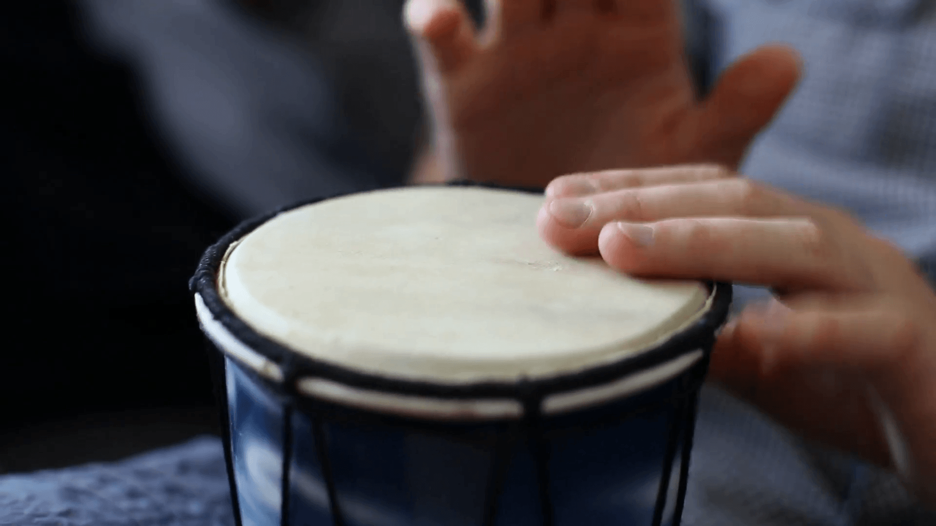 Playing Bongo drum close up HD stock footage. Hand tapping a Bongo