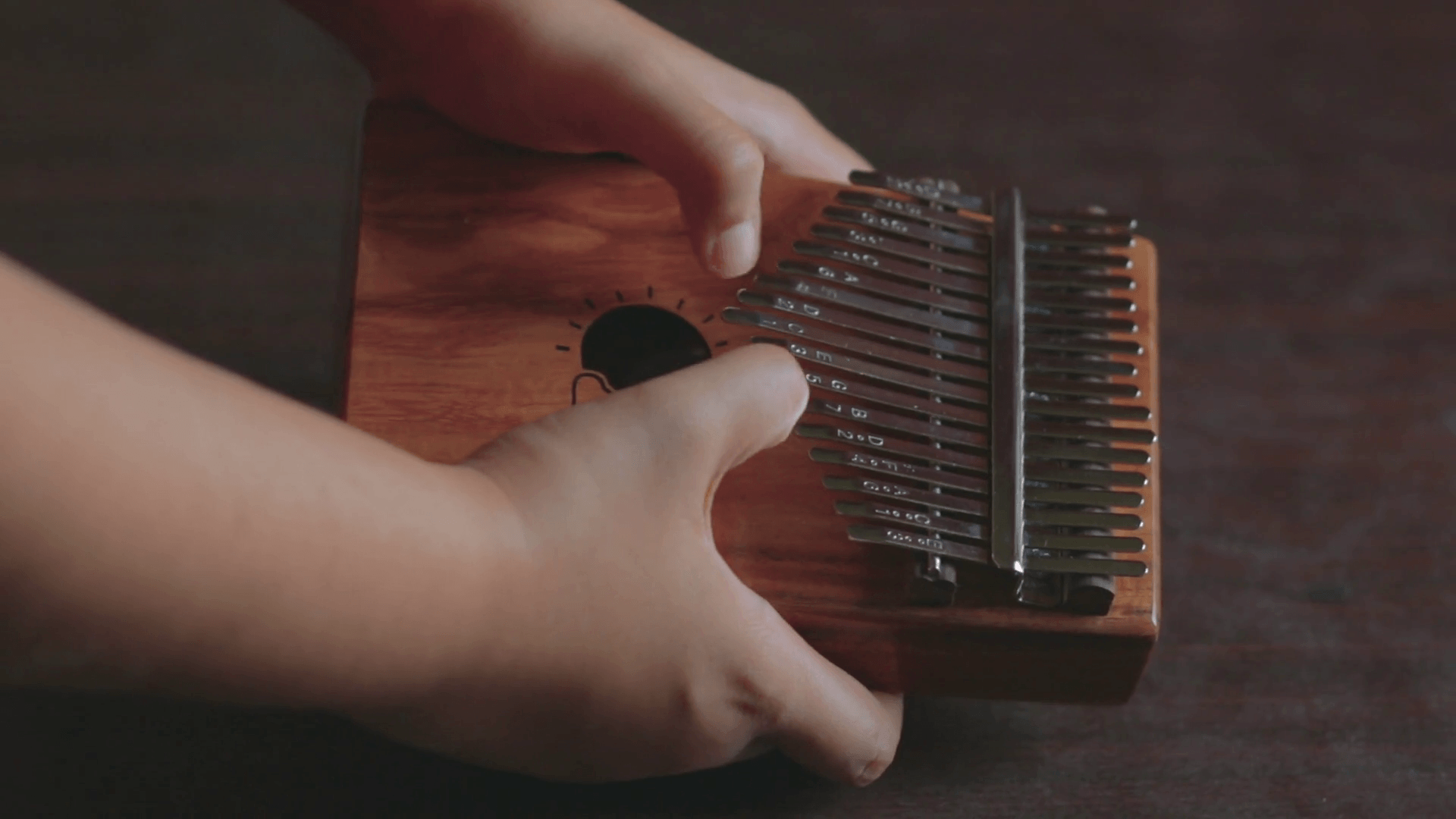Playing chords on Kalimba. It is an African musical instrument