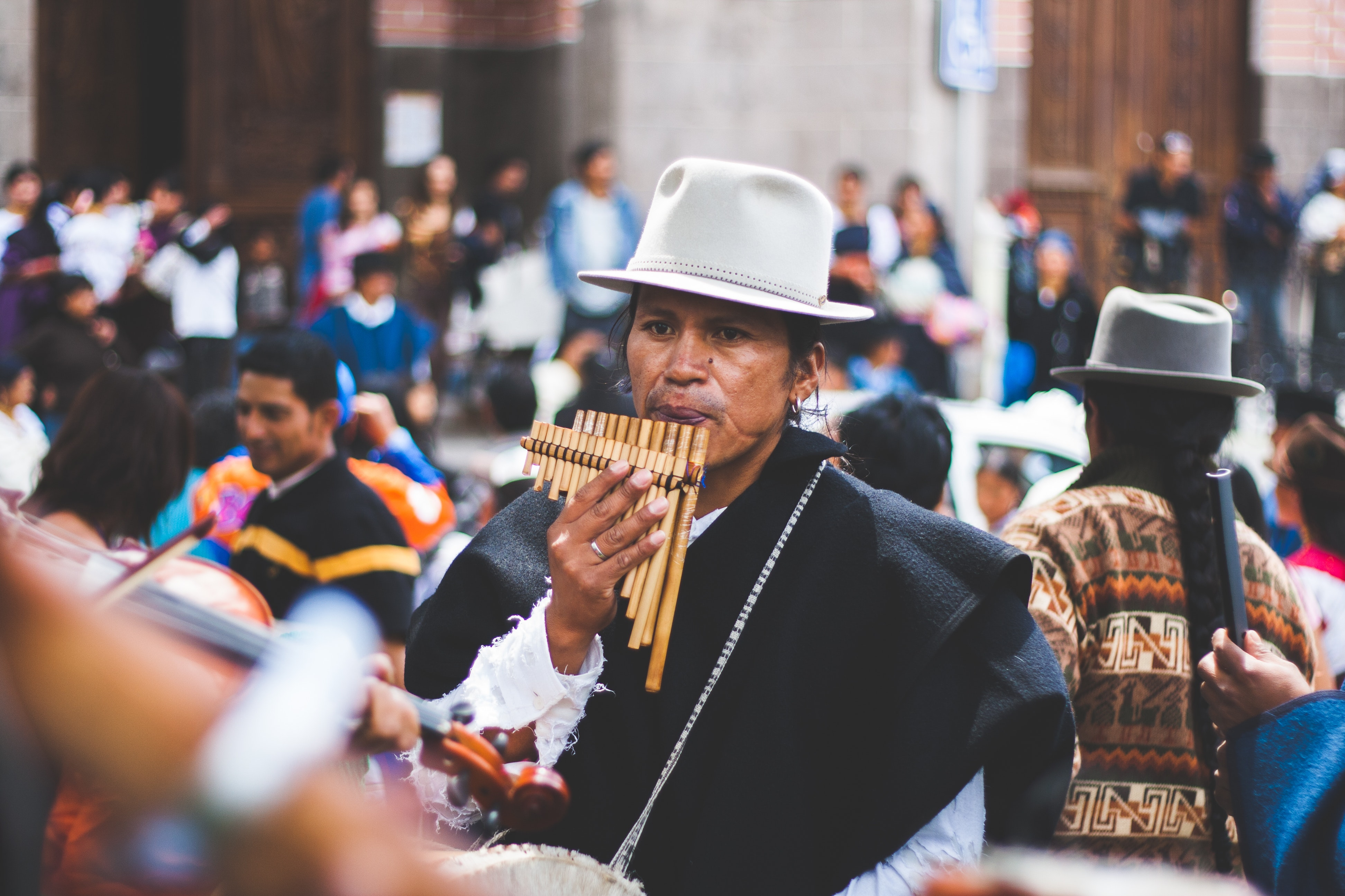 Man Playing Bamboo Wind Instrument · Free Stock Photo