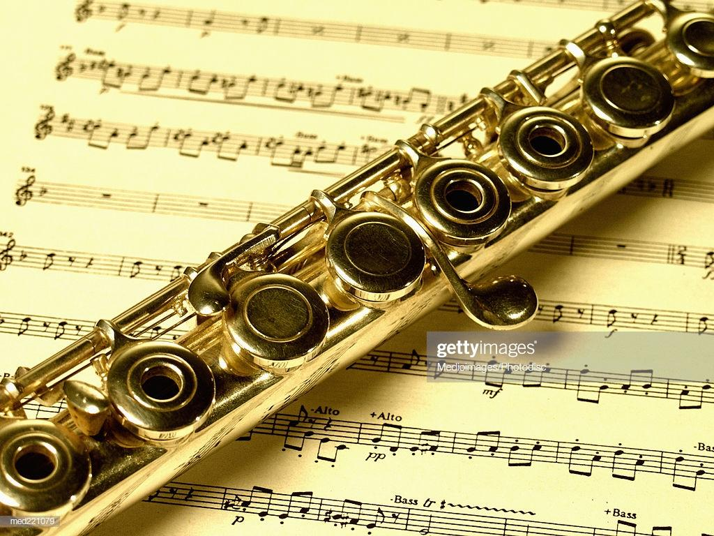 Closeup Of A Flute On A Sheet Music Stock Photo