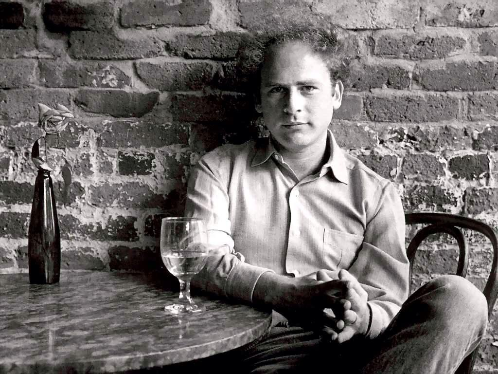 Art Garfunkel having a glass.