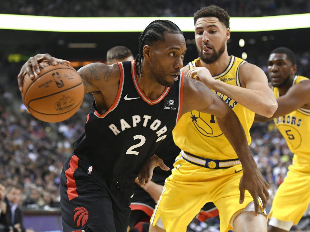 Kawhi Leonard, Raptors outlast Warriors in thrilling OT win