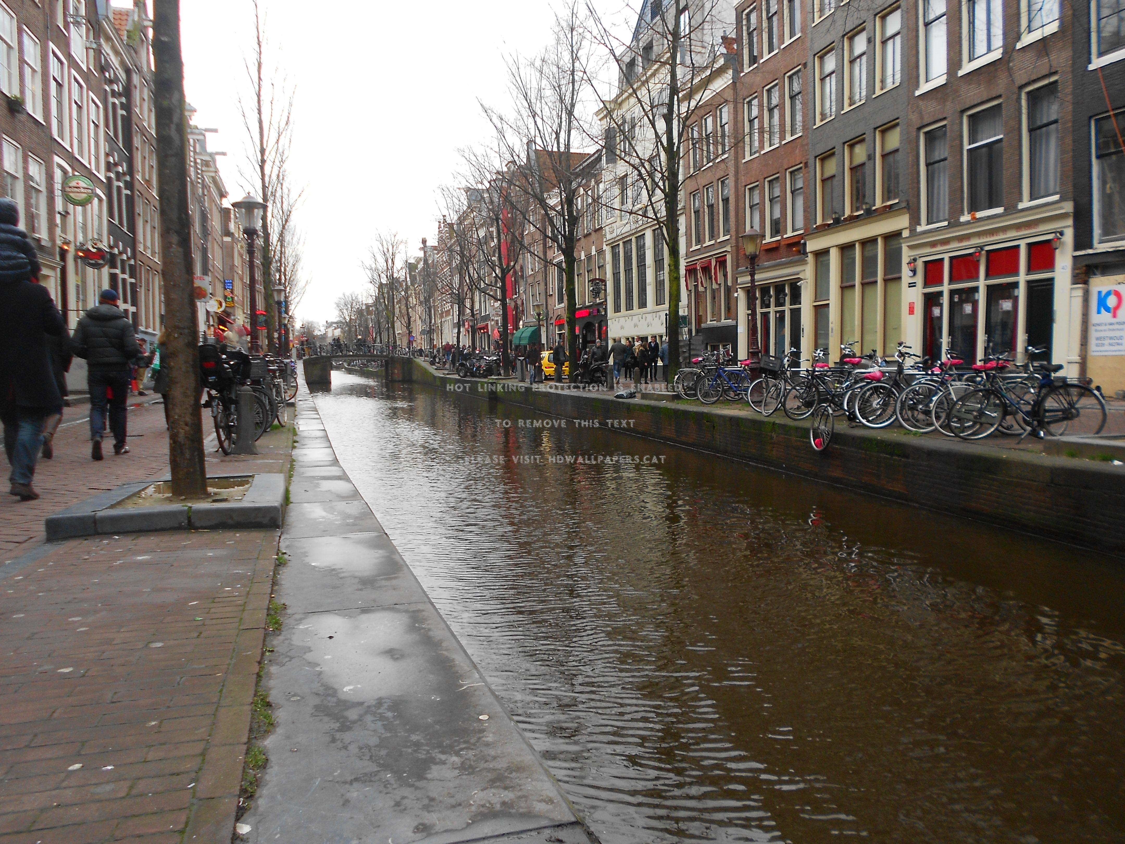 red light district in amsterdam canal day