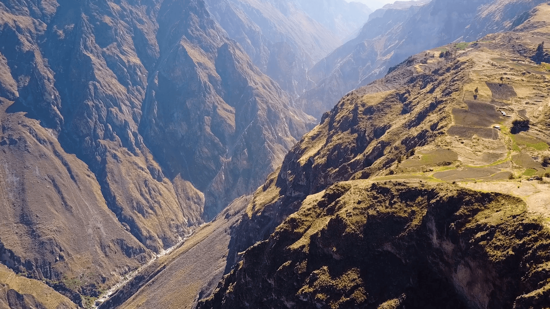 Drone aerial flying sideways over the massive Colca Canyon valley in