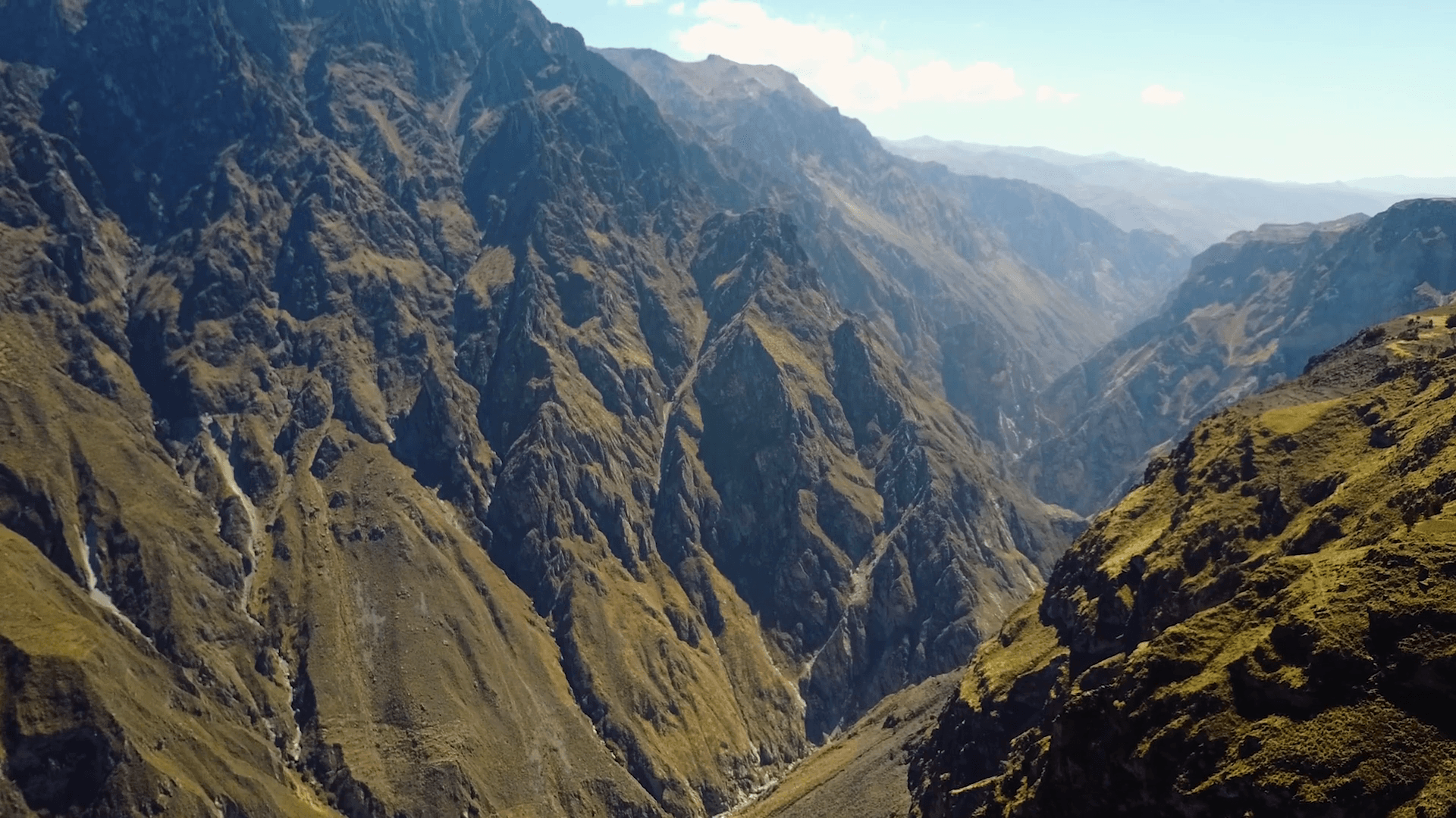 Slow drone aerial flying over the stunning Colca Canyon in Peru