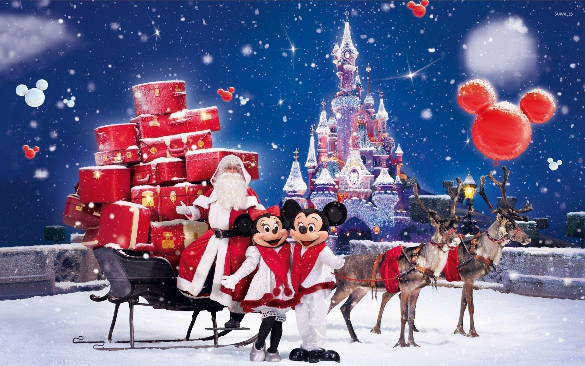 Santa Claus bringing gifts in a Disneyland park wallpapers