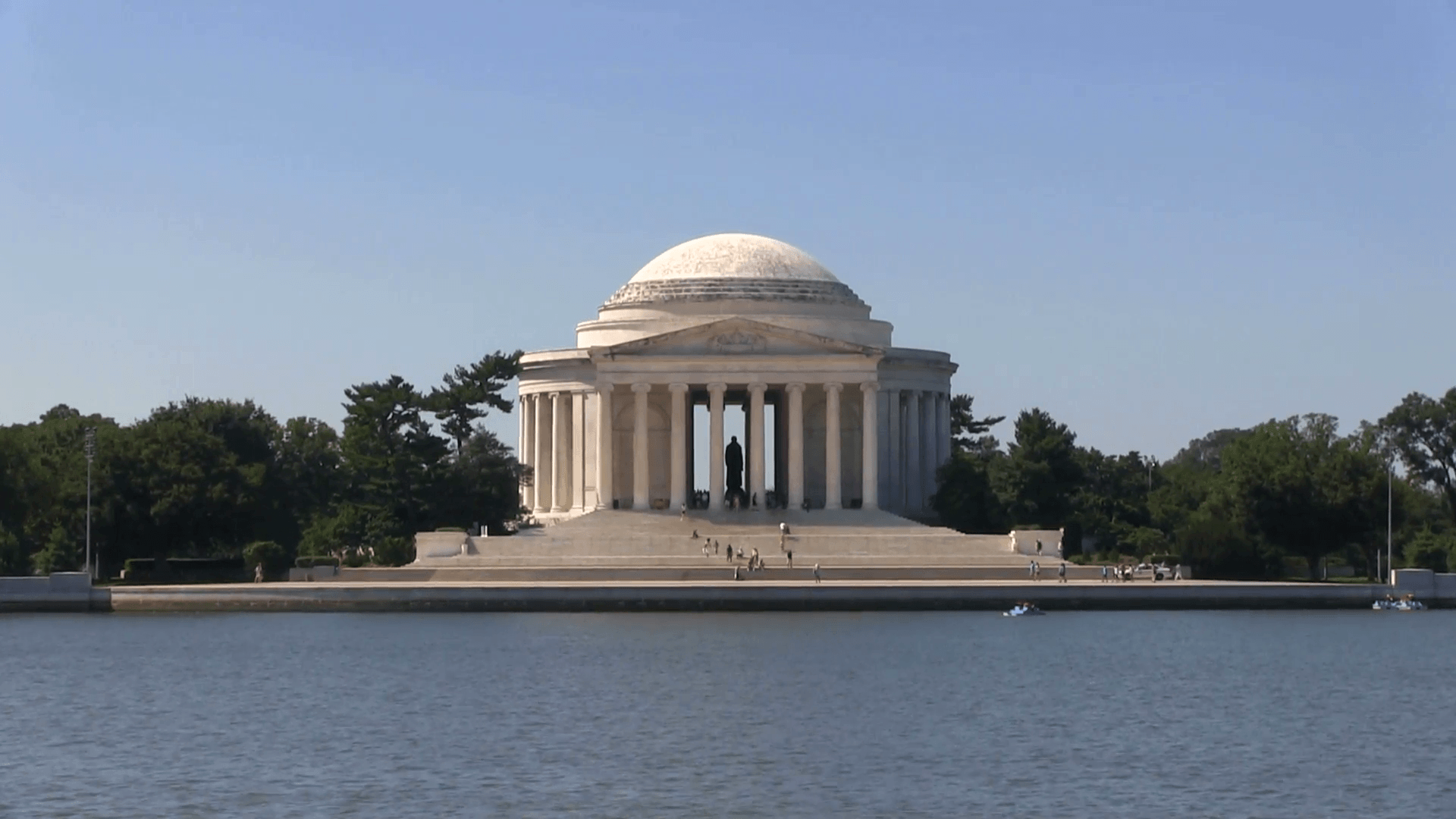Tourists climb the steps of the Thomas Jefferson Memorial shot from