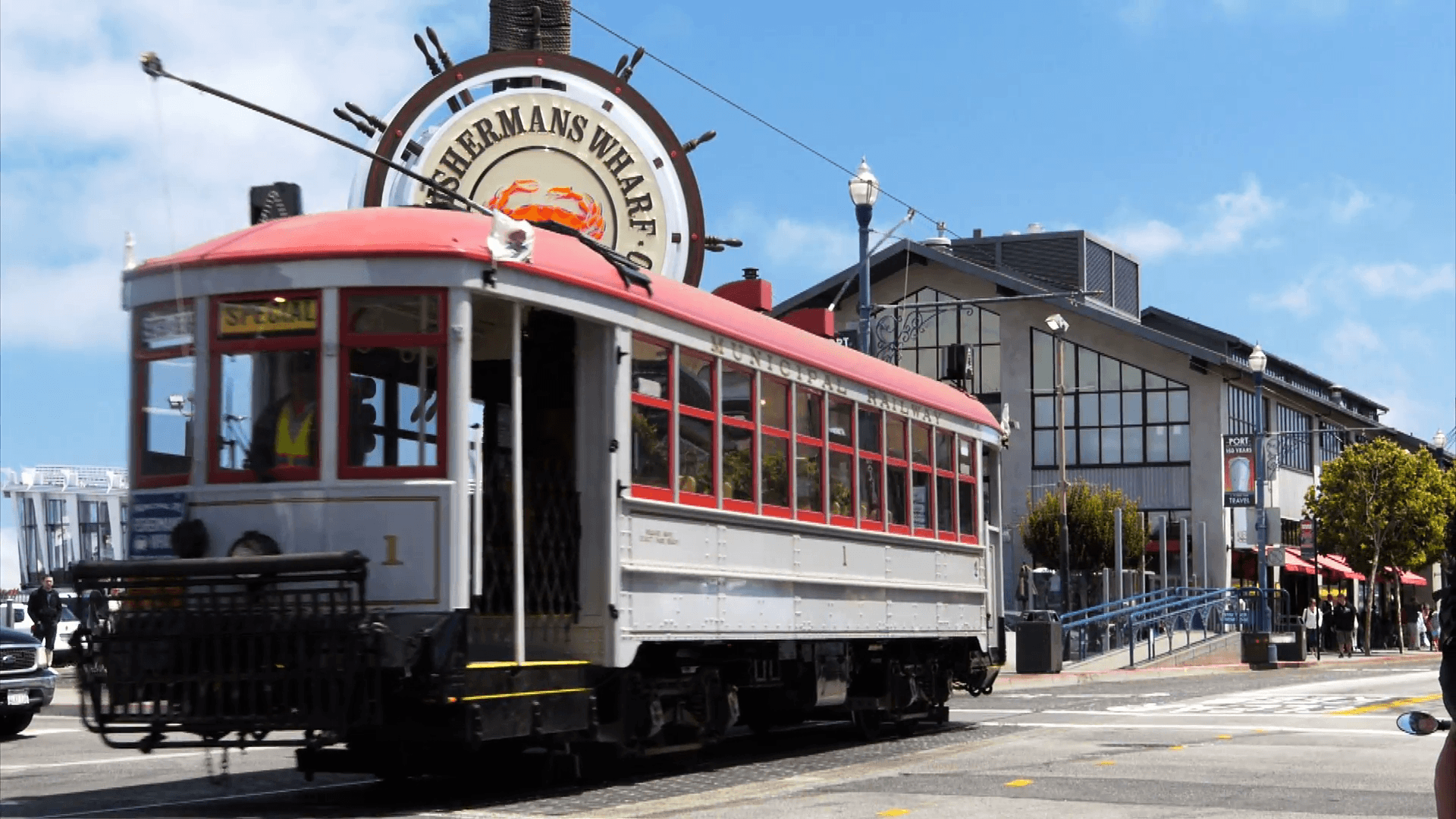 a cable car travels past the famous fisherman's wharf district of ...