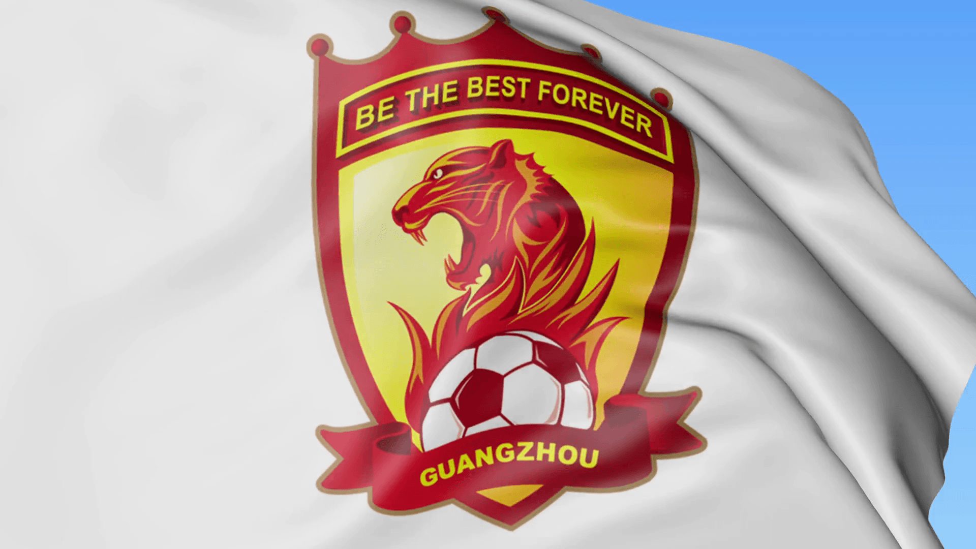 Close-up of waving flag with Guangzhou Evergrande Taobao FC football ...